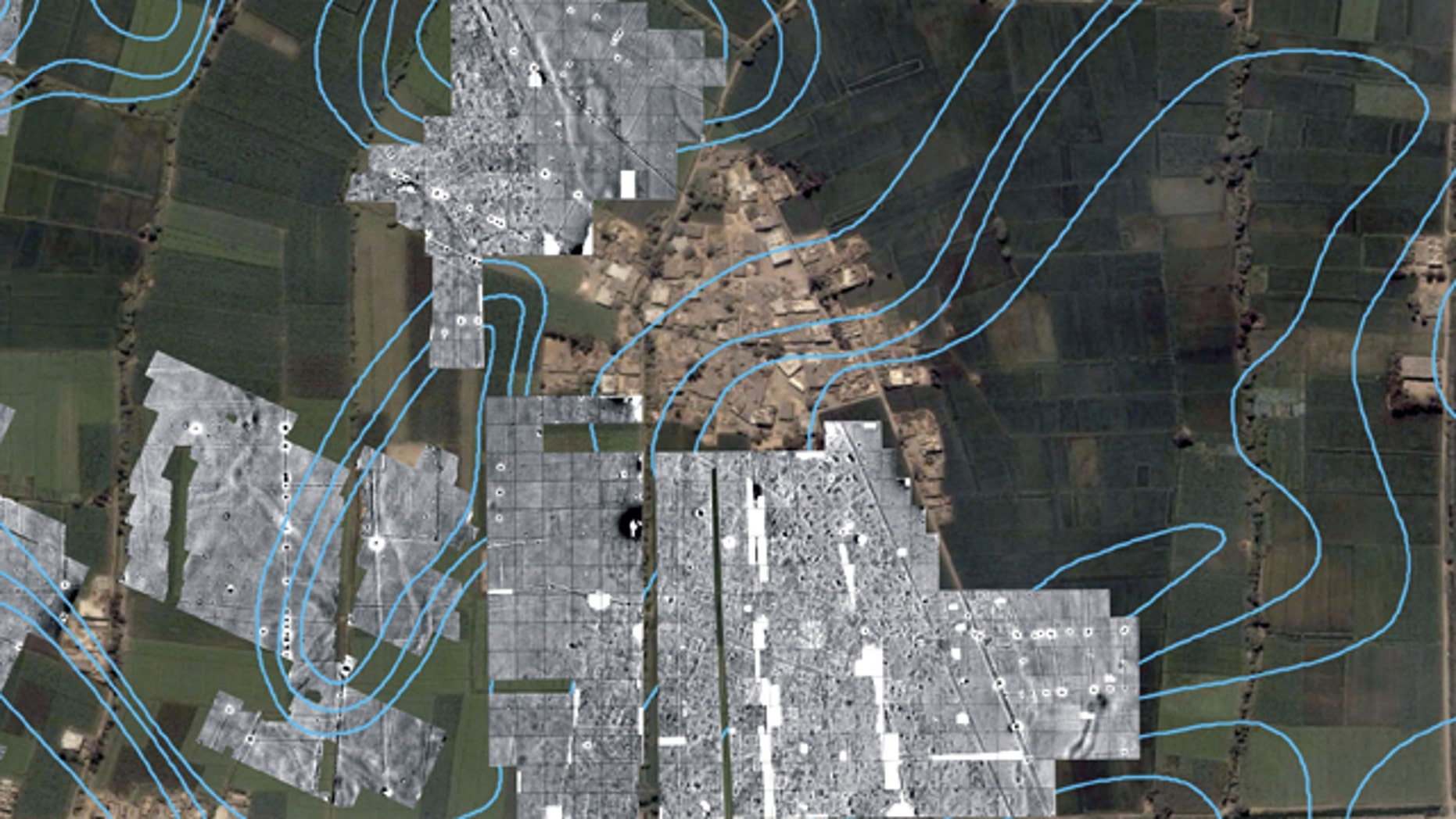 A color satellite image with radar imaging in monochrome showing the outlines of streets, houses and temples underneath the green farm fields and modern town of Tel al-Dabaa, in Egypt. An Austrian archaeological team has used radar imaging to determine the size of the 3,500-year-old capital of Egypt's foreign occupiers, the Hyksos warrior people from Asia, the antiquities department said Sunday.