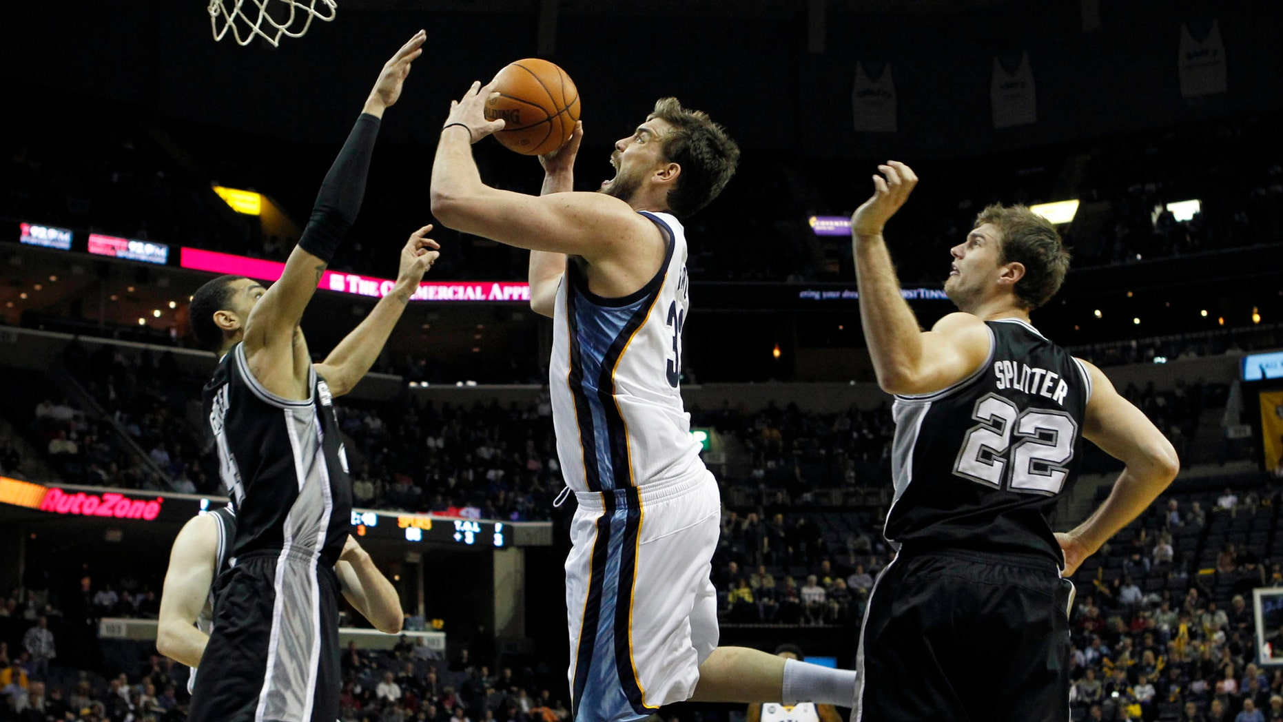 Memphis Grizzlies center Marc Gasol, of Spain, (33) shoots under pressure by San Antonio Spurs forward Danny Green (4) in the second half of an NBA basketball game on Monday, Feb. 6, 2012, in Memphis, Tenn. (AP Photo/Jim Weber)