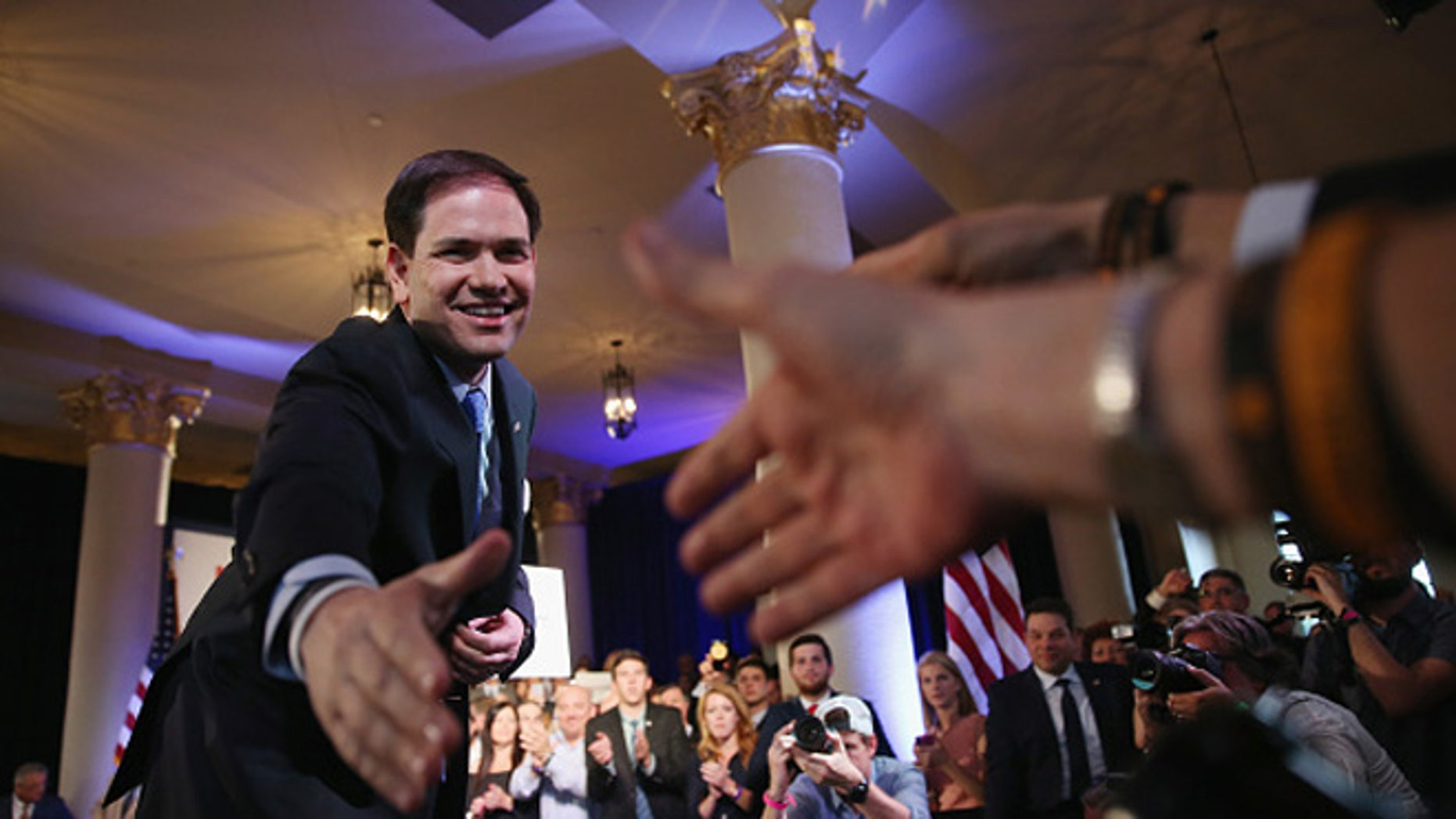 MIAMI, FL - APRIL 13:  U.S. Sen. Marco Rubio (R-FL) greets people after announcing his candidacy for the Republican presidential nomination during an event at the Freedom Tower on April 13, 2015 in Miami, Florida. Rubio is one of three Republican candidates to announce their plans on running against the Democratic challenger for the White House.