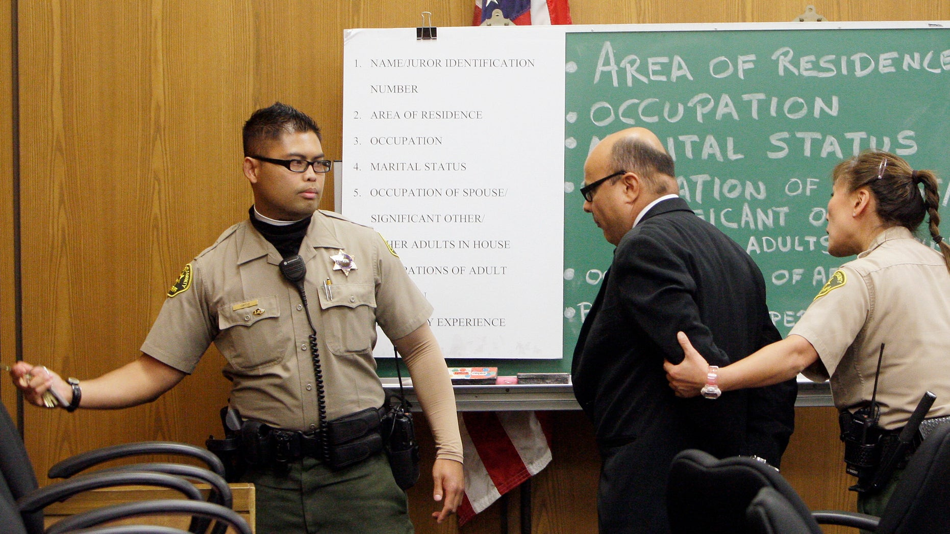 September 8: Truck driver Marcos Costa, middle, is taken into custody after his sentencing in court to seven years and four months in state prison in Pasadena, California. Costa was behind the wheel of a double-decker hauler that lost its brakes on a mountain highway, descended into a Los Angeles foothill suburb in April 2009. The rig smashed into cross-traffic and a building, killing two people.