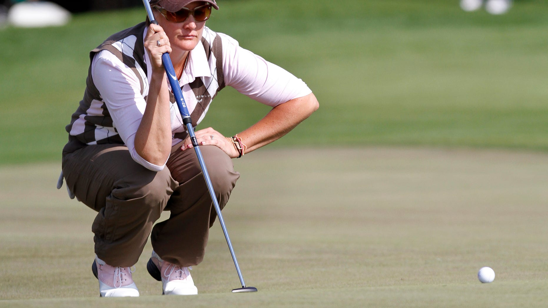 Maria Hjorth, of Sweden, lines up a putt on the fifth green during the final round of the LPGA Tour Championship golf tournament in Orlando, Fla., Sunday, Dec. 5, 2010. (AP Photo/Reinhold Matay)