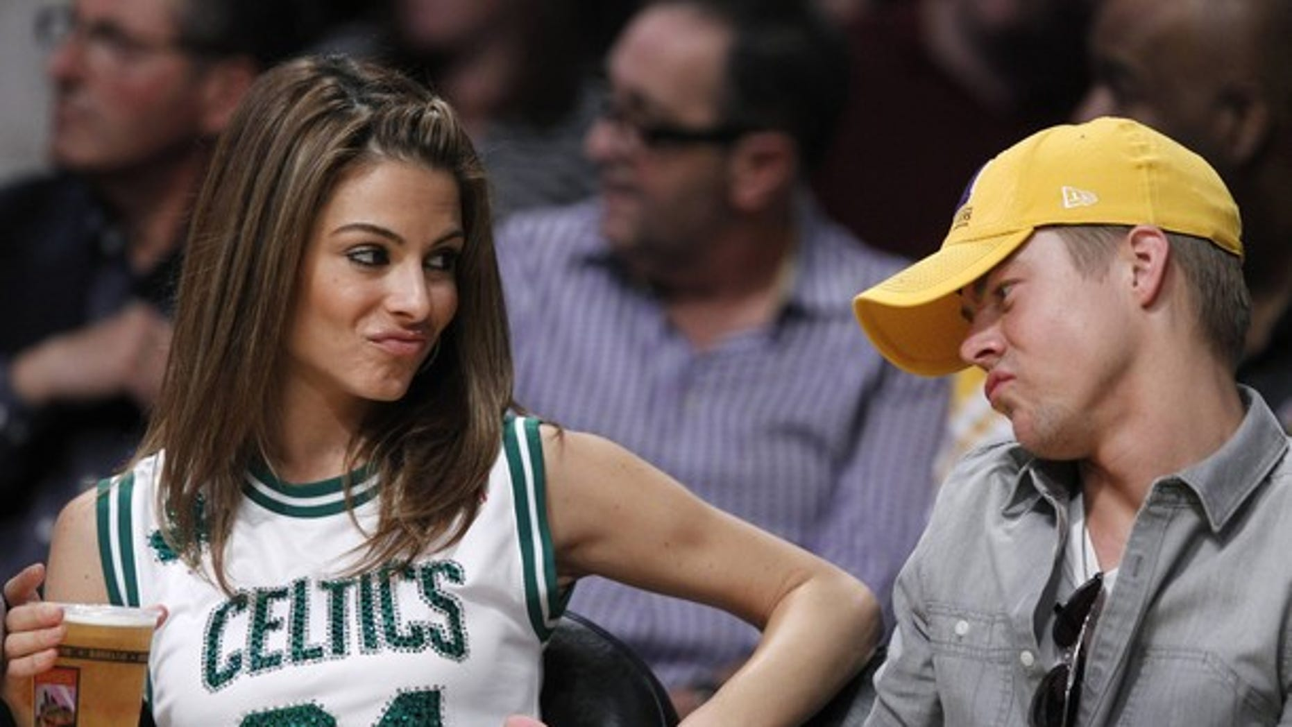 "Actress Maria Menounos and ""Dancing With the Stars"" pro Derek Hough sit courtside as the Boston Celtics play the Los Angeles Lakers during their NBA basketball game in Los Angeles, California March 11, 2012. REUTERS/Lucy Nicholson (UNITED STATES - Tags: SPORT BASKETBALL ENTERTAINMENT)"