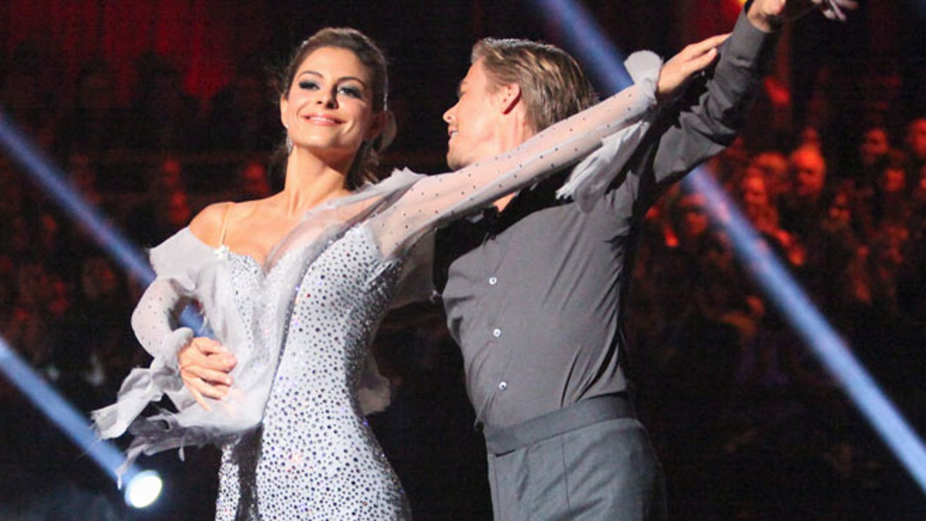 "In this Monday, May 7, 2012 photo, TV personality Maria Menounos, left, and her partner Derek Hough perform on the celebrity dance competition series, ""Dancing with the Stars,"" in Los Angeles."