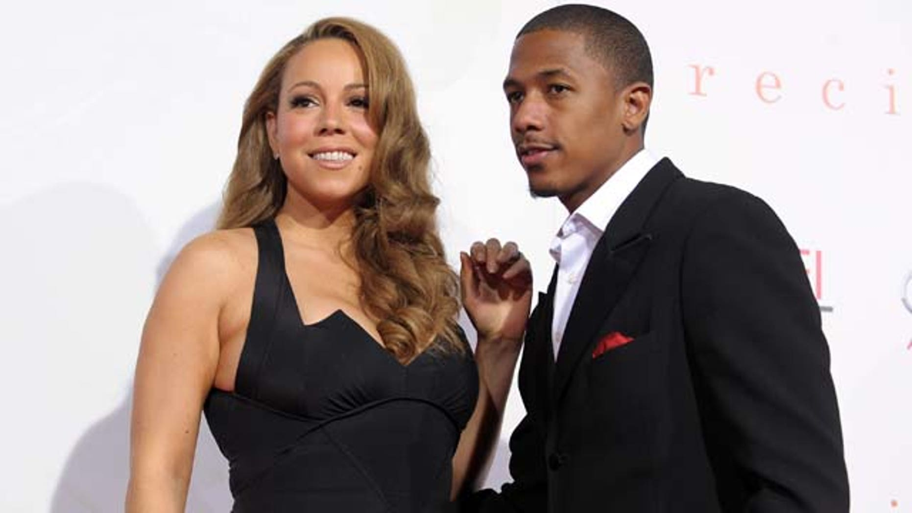 "HOLLYWOOD - NOVEMBER 01:  Actress/singer Mariah Carey (L) and actor Nick Cannon arrive at the screening of ""Precious: Based On The Novel 'PUSH' By Sapphire"" during AFI FEST 2009 held at Grauman's Chinese Theatre on November 1, 2009 in Hollywood, California.  (Photo by Kevin Winter/Getty Images for AFI)"