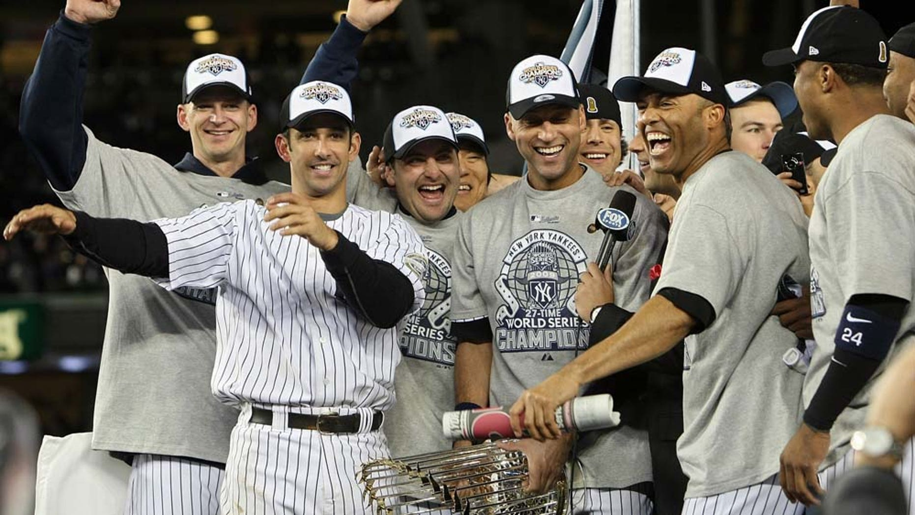 NEW YORK - NOVEMBER 04:  A.J. Burnett (L), Jorge Posada (2nd L), Derek Jeter #2 (C) and Mariano Rivera #42 of the New York Yankees celebrate with their teammates after their 7-3 win against the Philadelphia Phillies in Game Six of the 2009 MLB World Series at Yankee Stadium on November 4, 2009 in the Bronx borough of New York City.  (Photo by Nick Laham/Getty Images)