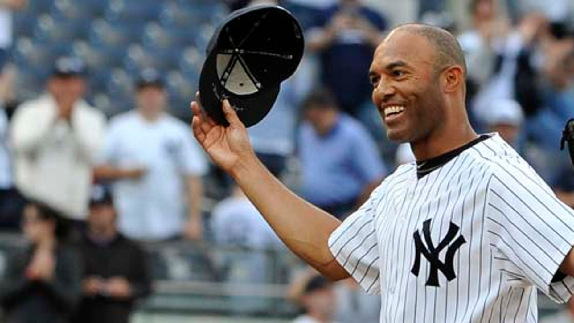 New York Yankees closer Mariano Rivera acknowledges the cheers of the crowd after recording his 602nd career save, after the Yankees beat the Minnesota Twins 6-4 in a baseball game, Monday, Sept. 19, 2011, at Yankee Stadium in New York. Rivera pitched a perfect ninth as he broke the record held by Trevor Hoffman. (AP Photo/Kathy Kmonicek)
