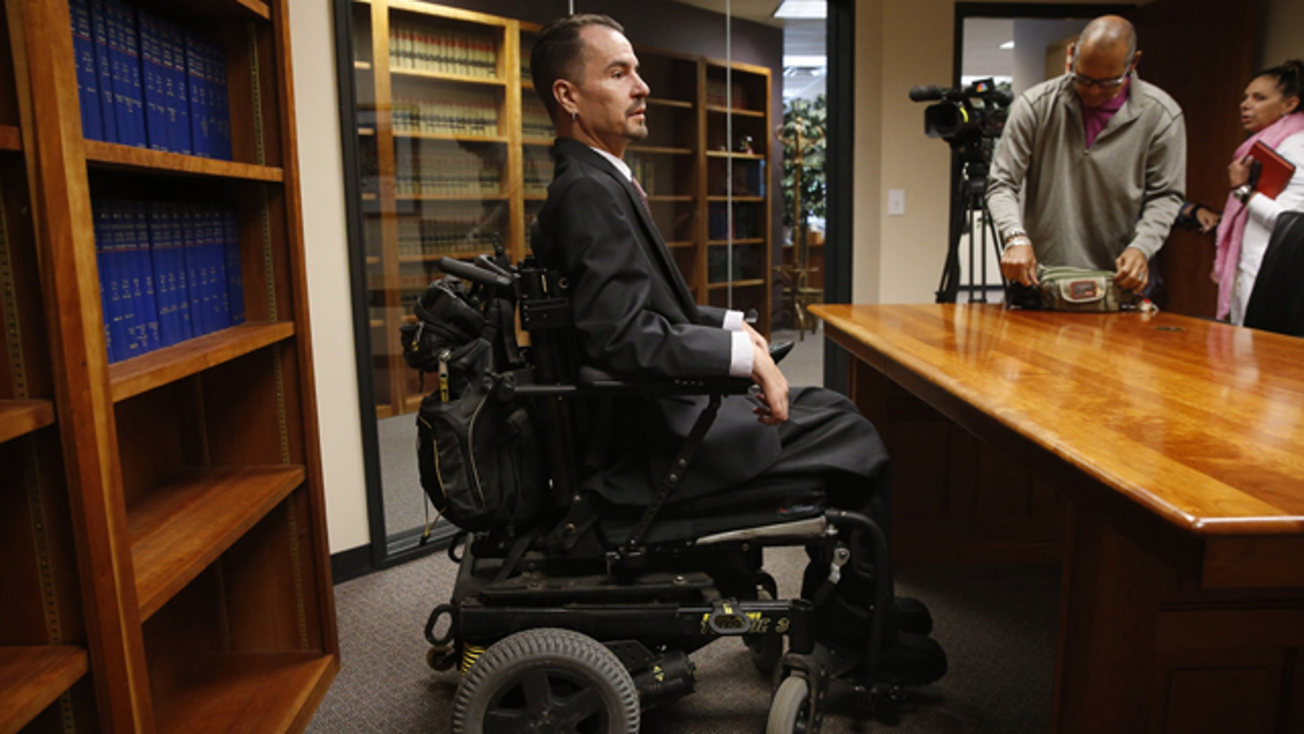 June 15, 2015: Brandon Coats prepares to take questions from members of the media after the Colorado Supreme Court ruled against him, at his attorney's offices in Centennial, Colo. (AP Photo/Brennan Linsley)