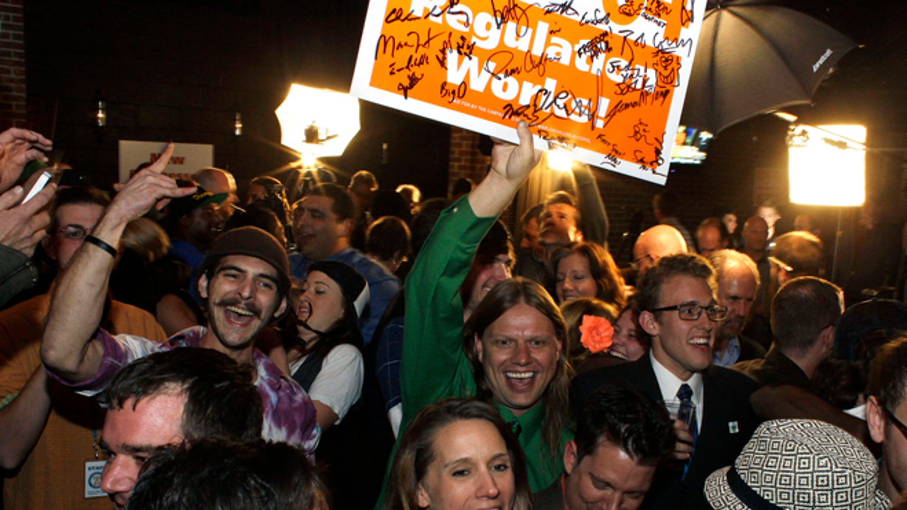 Nov. 6, 2012: People attending an Amendment 64 watch party in a bar celebrate after a local television station announced the marijuana amendment's passage, in Denver, Colo.