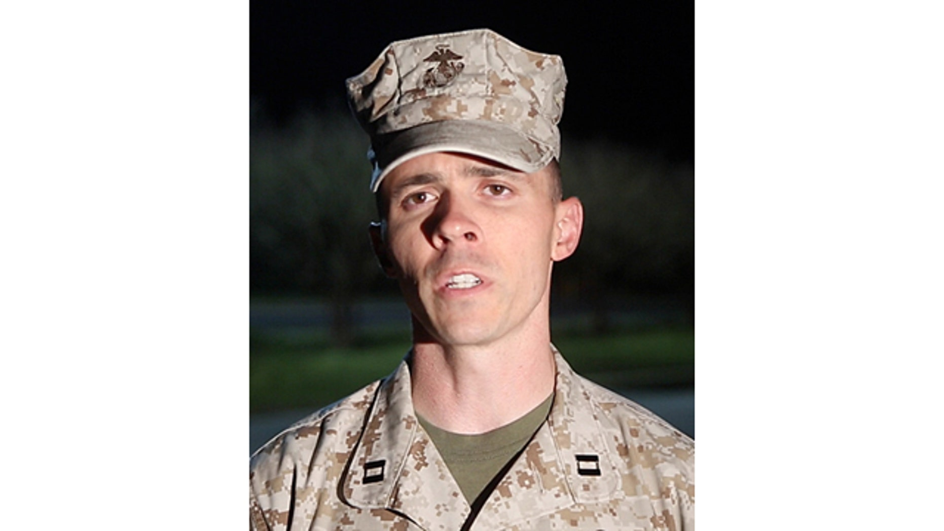 April 8, 2014: Capt. Joshua Smith, public affairs officer for Marine Corps Installations East, Camp Lejeune, Jacksonville, comments on the shooting  at Camp Lejeune. A Marine posted at the main gate of the North Carolina base shot and killed a colleague inside a guard shack, a military spokesman said. (AP Photo/John Althouse/The Daily News)