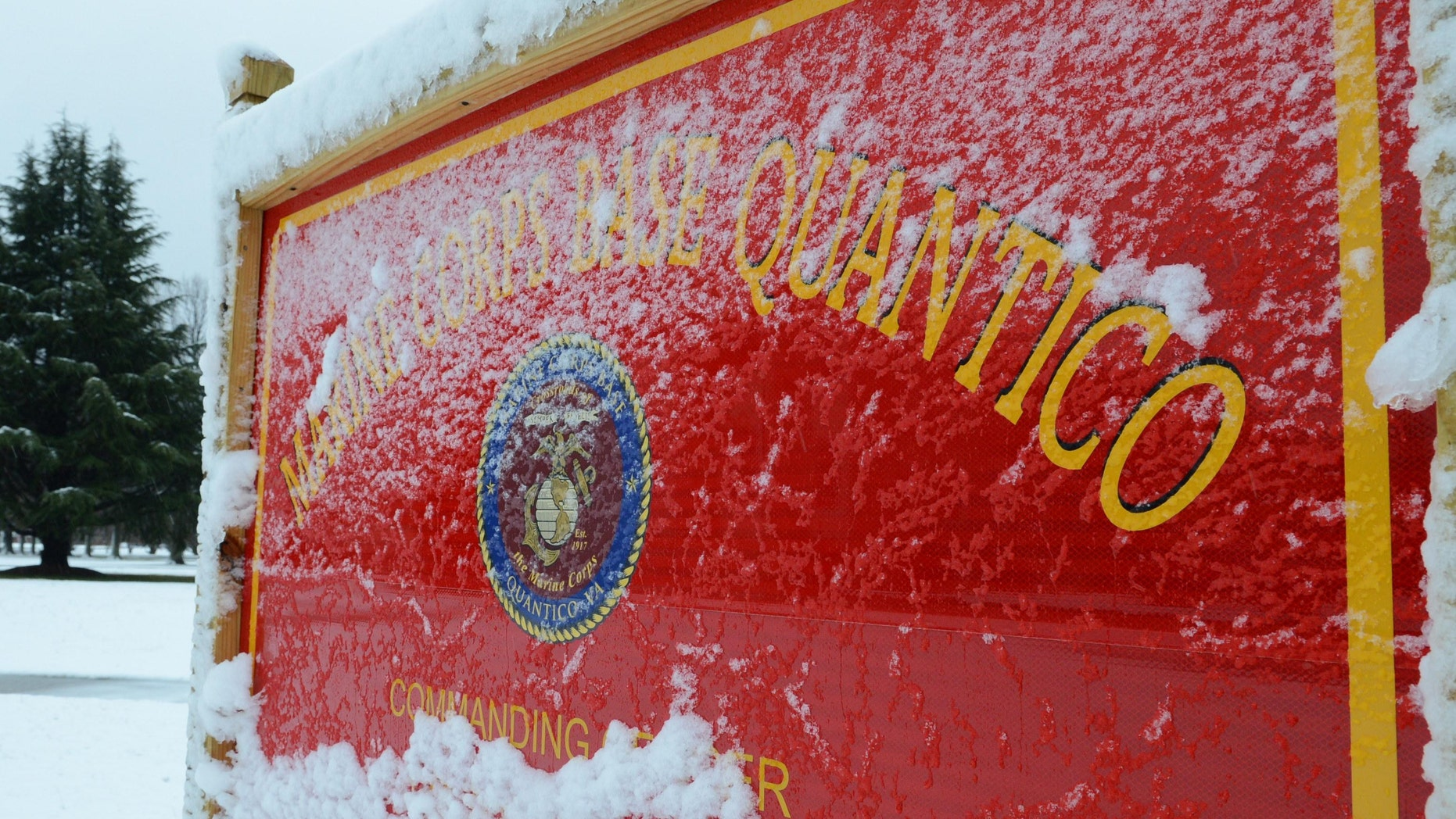 This image provided by the U.S. Marine Corps shows snow covering one of Marine Corps Base Quanticoâs many signs Wednesday March 6, 2013. One person was dead after a shooting at Marine Base Quantico and authorities were in a standoff early Friday March 22, 2013 with the suspect, who had barricaded himself in barracks, base spokesman Lt. Agustin Solivan said. Solivan said they believe the suspect, whose name wasn't released, is a staff member at the officer candidate school at the base. No information on the victim was immediately released. (AP Photo/US Marine Corps, Cpl. Antwaun L. Jefferson)