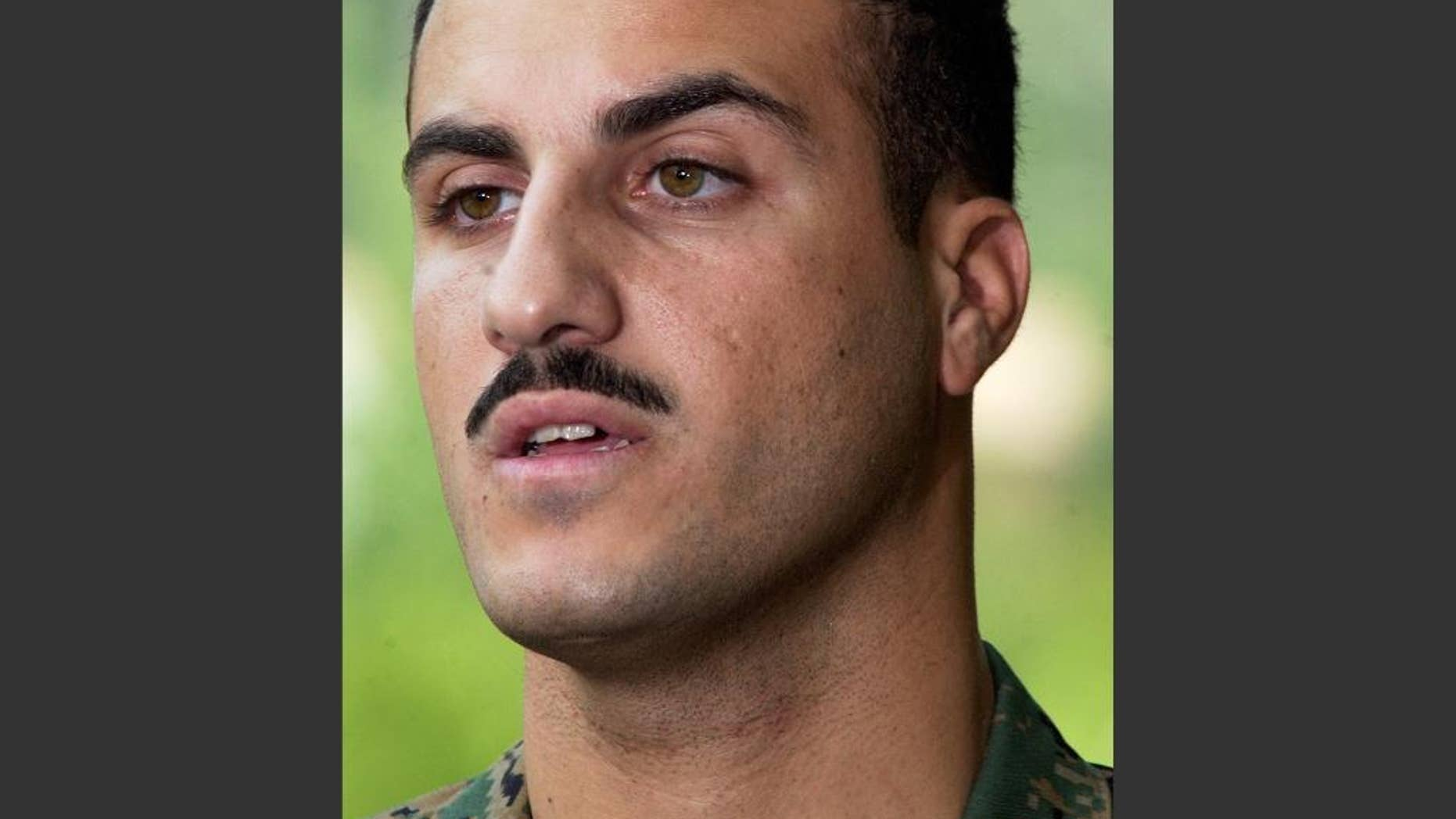 FILE - In this July 19, 2004 file photo, Marine Cpl. Wassef Ali Hassoun makes a statement to the media outside Quantico Marine Base in Quantico, Va. Marine spokesman Lt. Col. Cliff Gilmore said Wednesday, Nov. 19, 2014, that a judge decided last week to deny Cpl. Hassoun's request for another Article 32 hearing, the military equivalent of a grand jury hearing. Gilmore said Hassoun's general court-martial is scheduled to begin at Camp Lejeune on Dec. 8 before the judge, Marine Maj. Nicholas Martz. (AP Photo/Steve Helber, File)