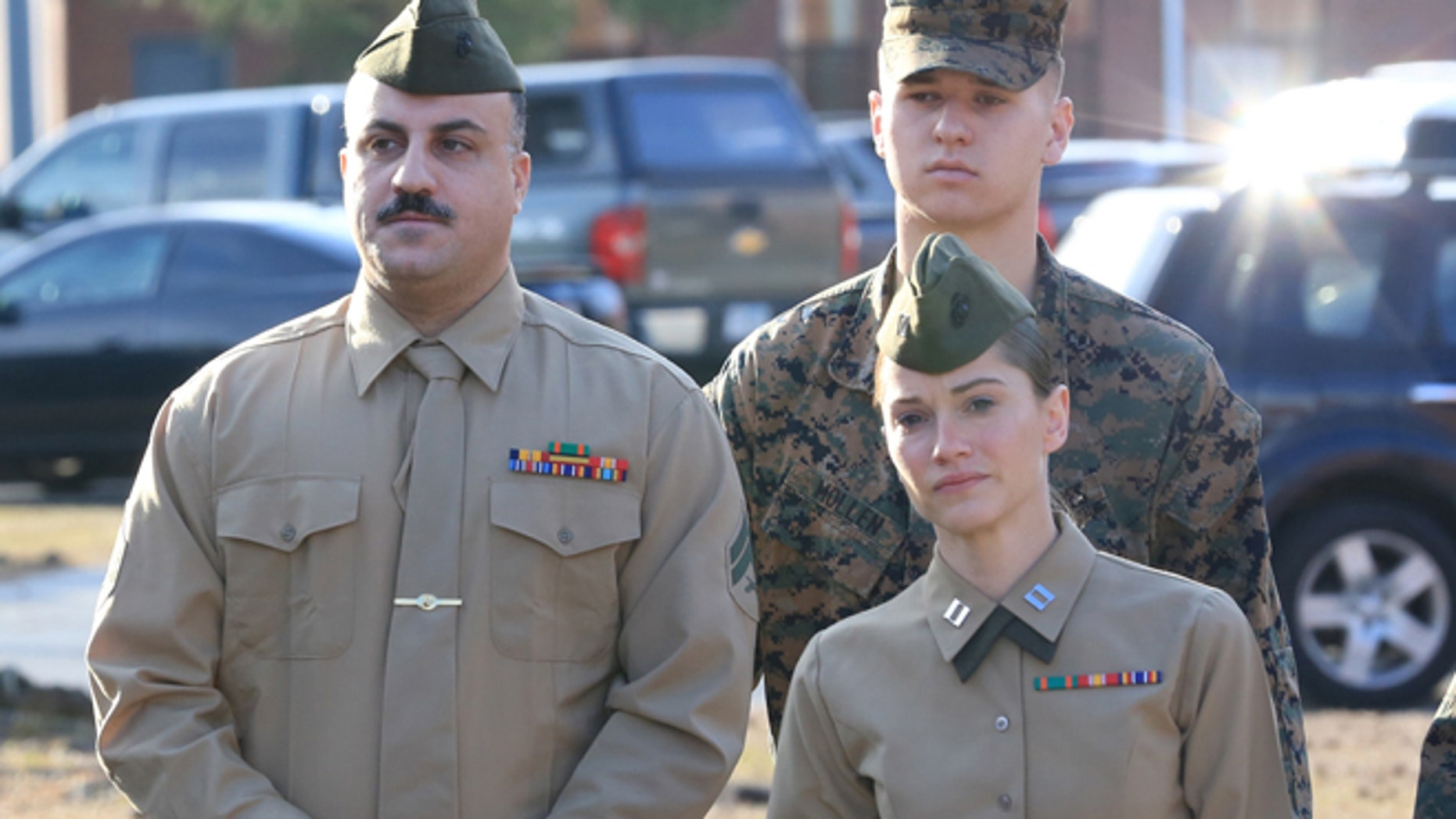 Feb. 9, 2015: Cpl. Wassef Hassoun, left, is escorted to the courtroom on Camp Lejeune in Jacksonville, N.C., for the beginning of his court martial trial.  (AP/The Daily News, John Althouse)