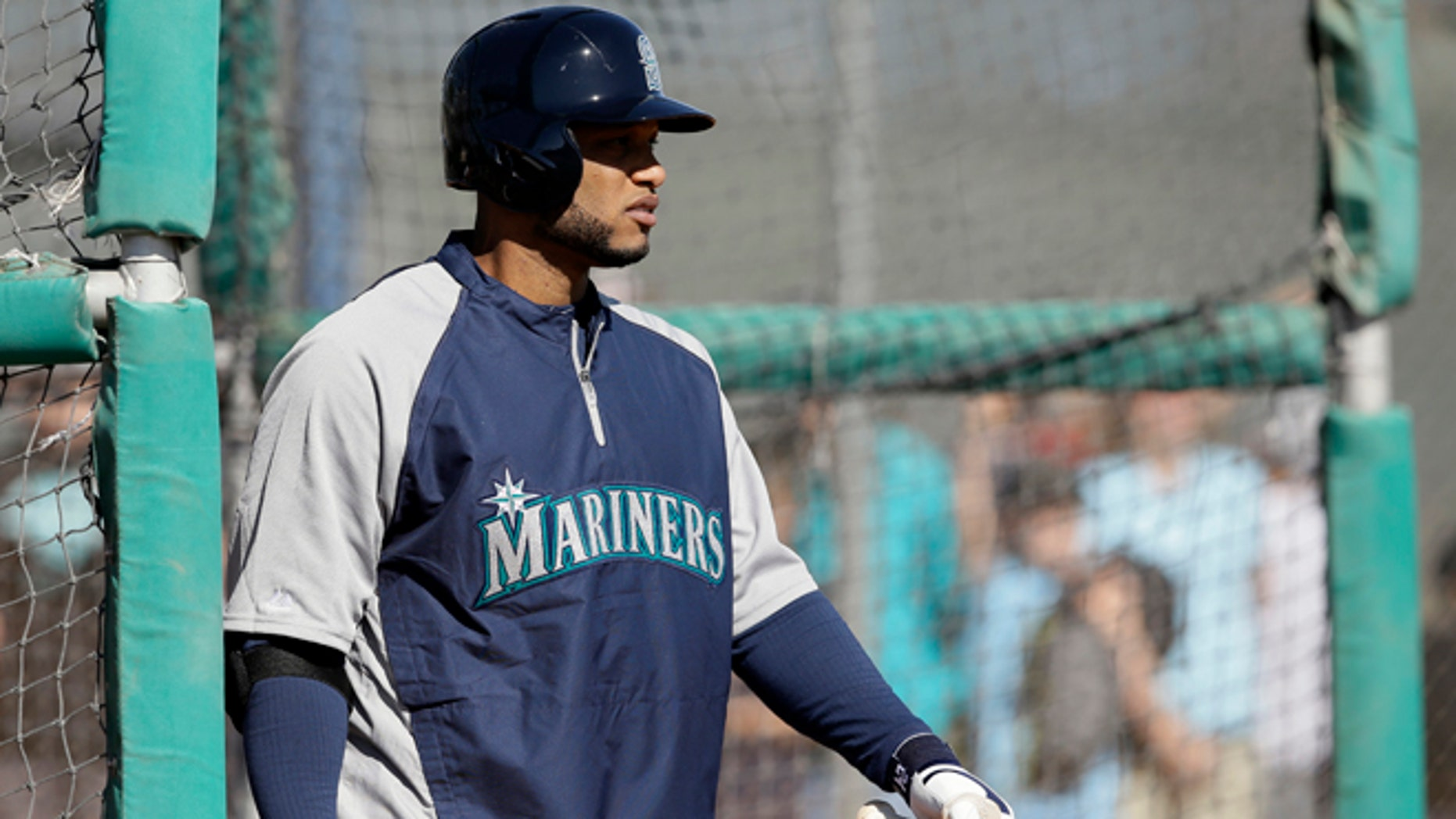 Seattle Mariners' Robinson Cano  walks out of the batting cage after hitting during spring training baseball practice, Thursday Feb. 20, 2014, in Peoria, Ariz. (AP Photo/Tony Gutierrez)