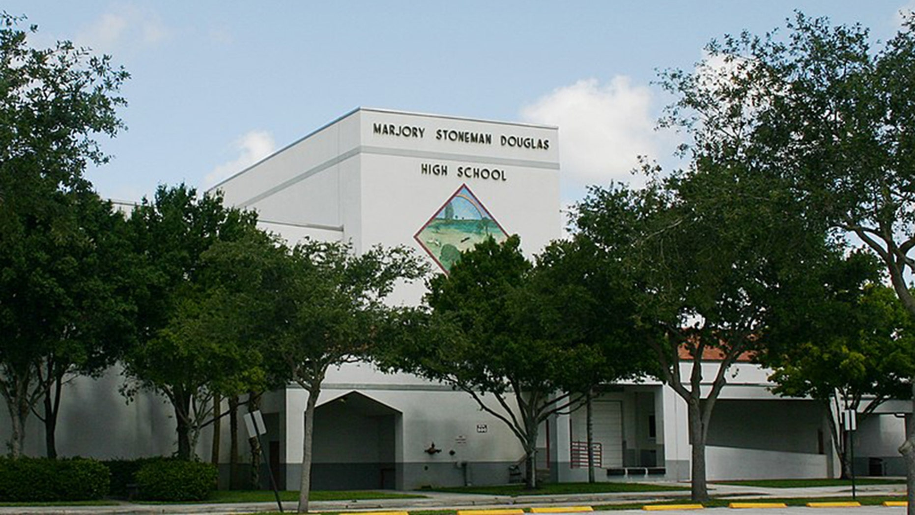 An unarmed campus monitor at Marjory Stoneman Douglas High School told police officers he warned school staff about Nikolas Cruz as the stormed the campus.