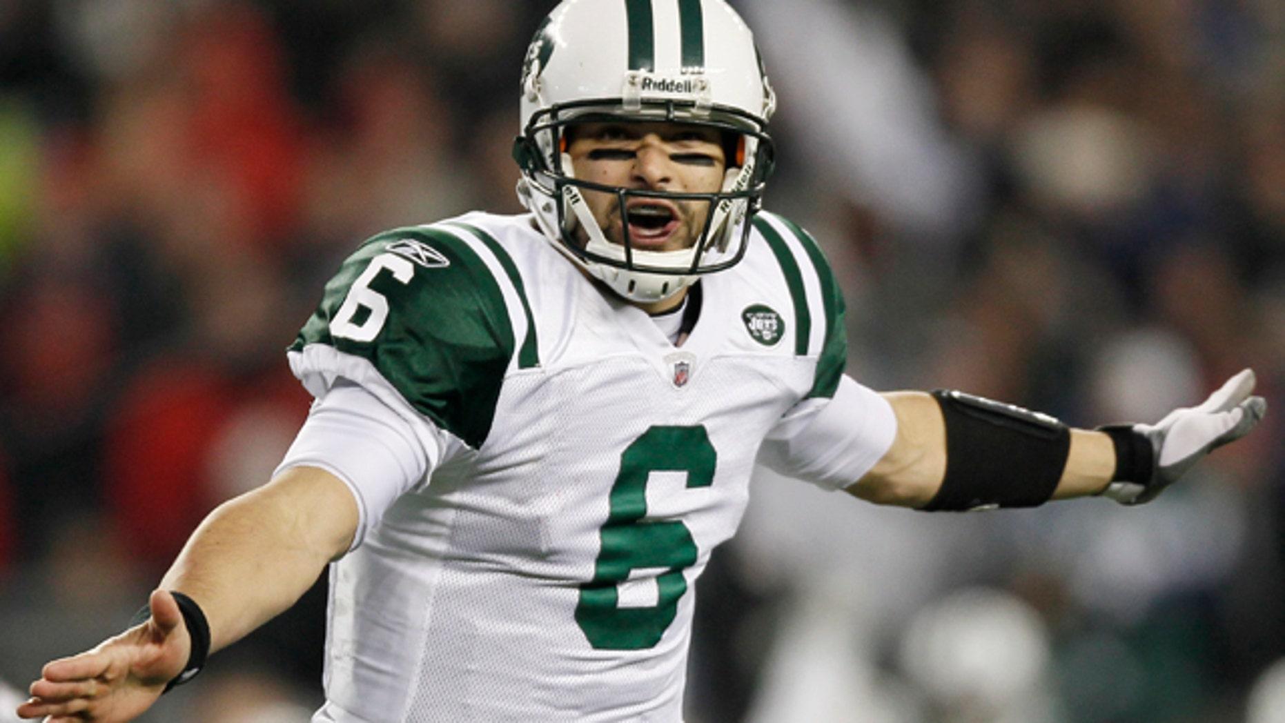 Jan. 16, 2011: New York Jets quarterback Mark Sanchez celebrates his touchdown pass to Santonio Holmes during the second half.