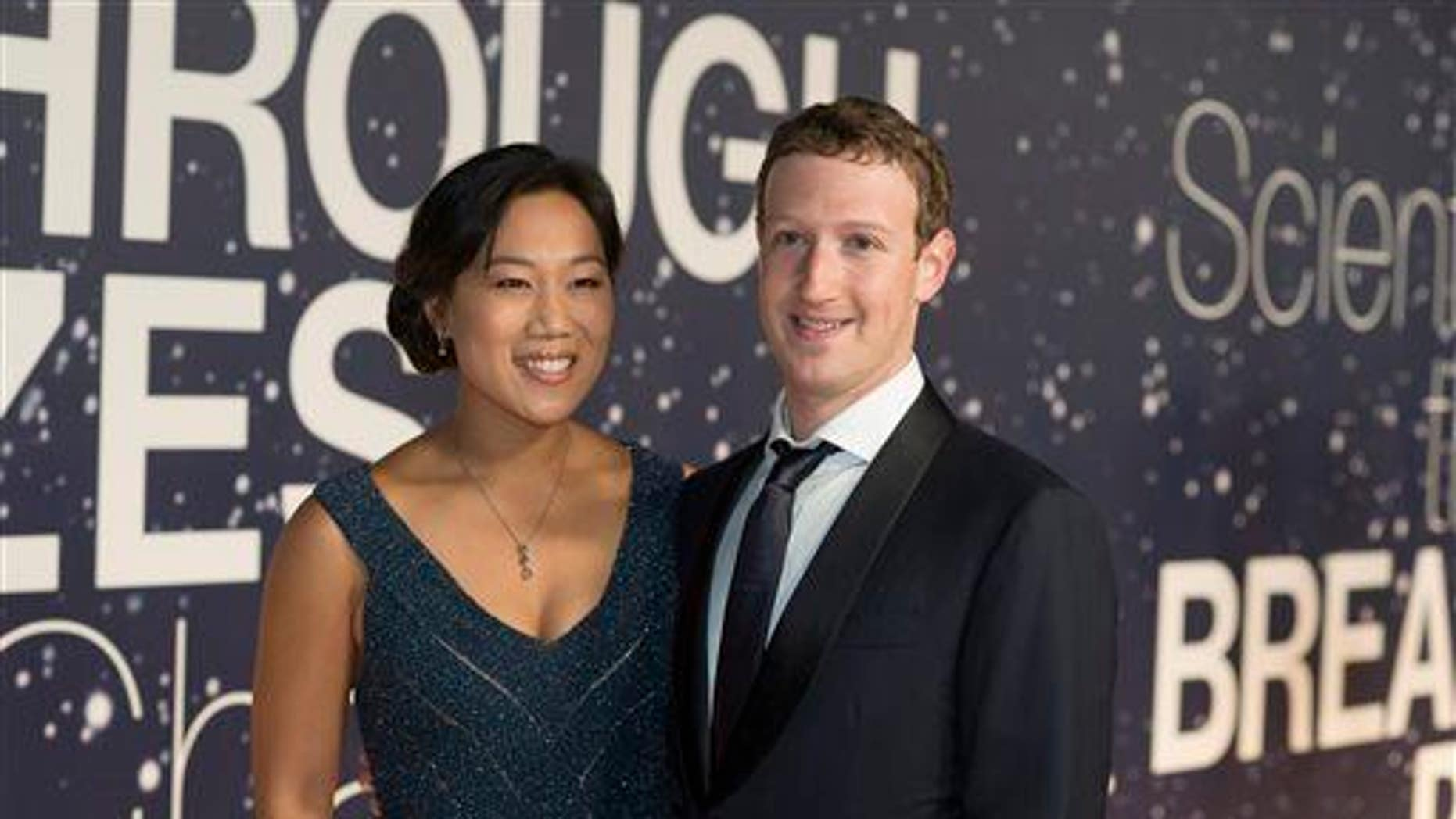 Priscilla Chan and Mark Zuckerberg arrive at the 2nd Annual Breakthrough Prize Award Ceremony at the NASA Ames Research Center on Nov. 9, 2014, in Mountain View, California.