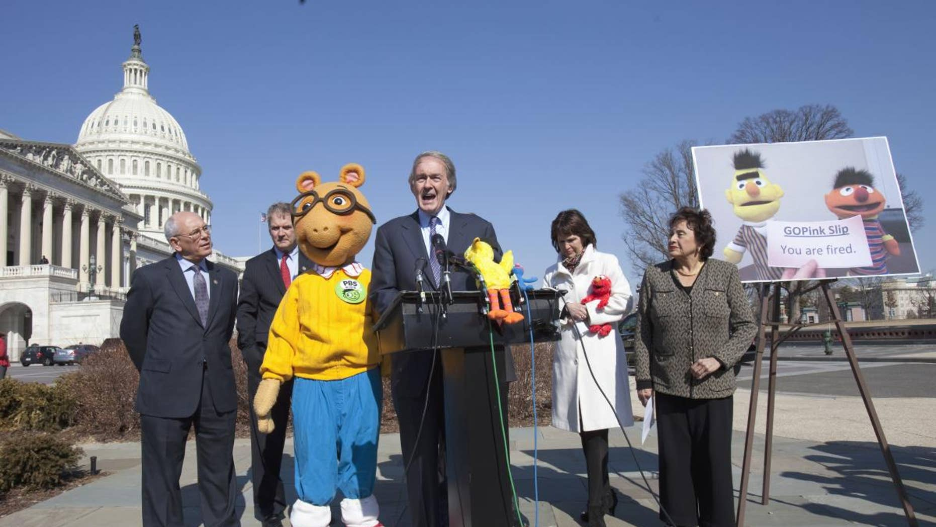 Rep. Ed Markey, D-Mass., center, accompanied by, from left, Rep. Paul Tonko, D-N.Y., Rep. Bill Owens, D-N.Y., Arthur the Aardvark, Rep. Betty McCollum, D-Minn., and Rep. Nita Lowey, D-N.Y., speaks during news conference on Capitol Hill in Washington on Wednesday, Feb. 16, 2011, to discuss the future of Public Broadcasting. (AP Photo/Harry Hamburg)