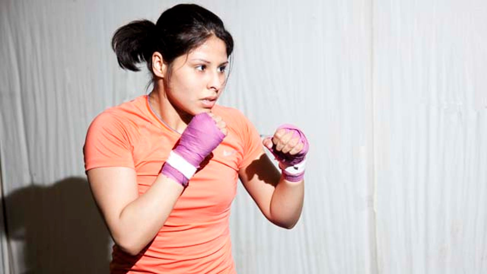 Marlen Esparza, a Houston-based boxing, is fighting to make history at the 2012 Olympics.