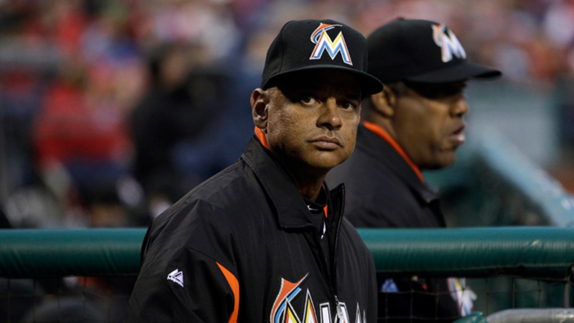 Miami Marlins bench coach Joey Cora watches a baseball game against the Philadelphia Phillies, Wednesday, April 11, 2012, in Philadelphia.