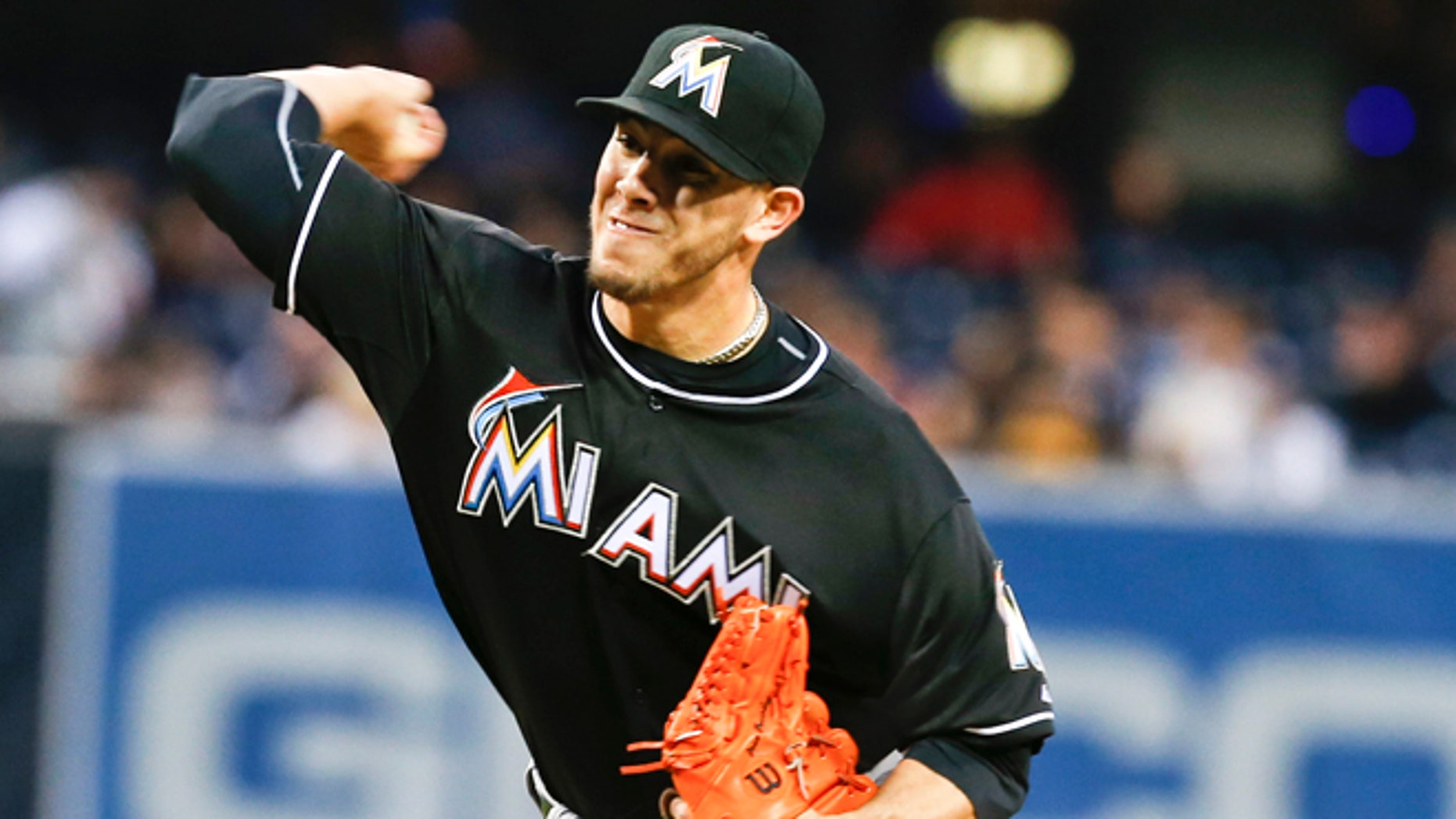 Miami Marlins starting pitcher Jose Fernandez works the first inning against the San Diego Padres during a baseball game on Friday, May 9, 2014, in San Diego.  (AP Photo/Lenny Ignelzi)