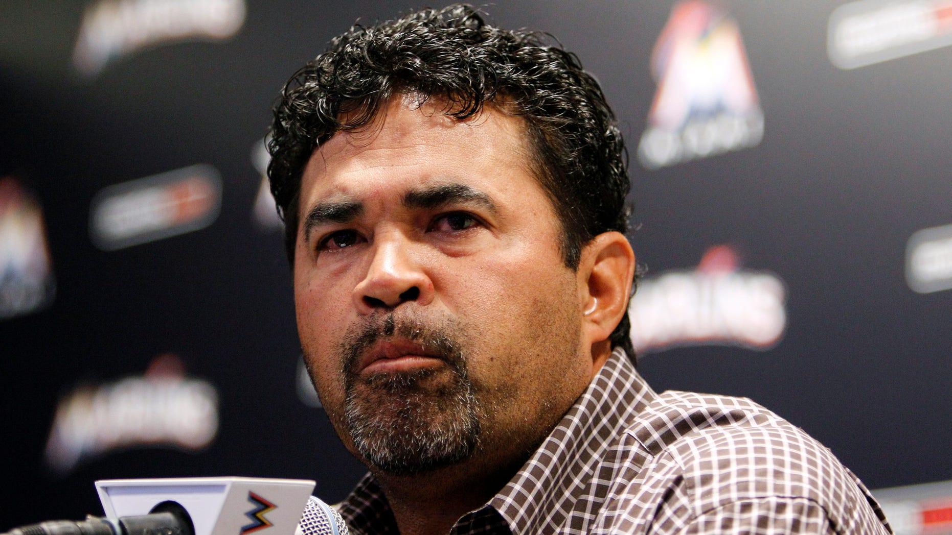 April 10. 2012: Miami Marlins manager Ozzie Guillen pauses as he speaks at a news conference at Marlins Stadium in Miami, Tuesday April 10, 2012.