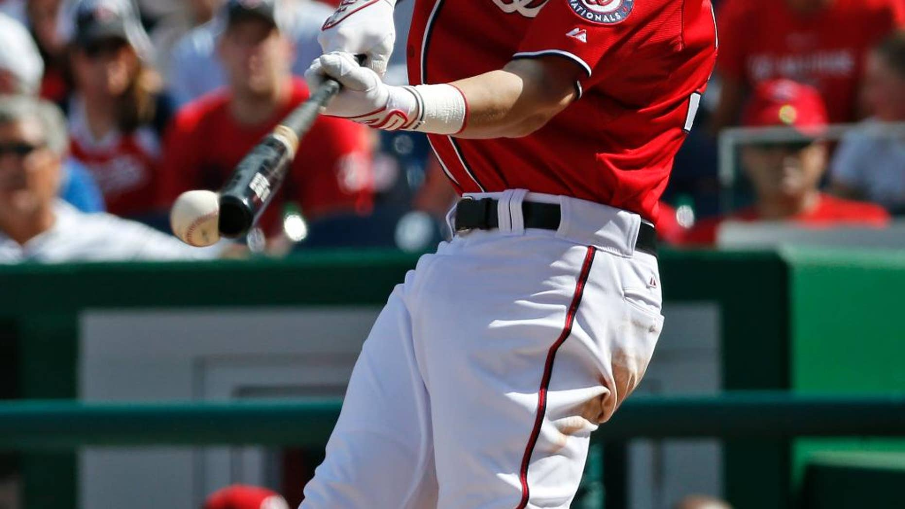 Washington Nationals' Bryce Harper hits a single during the fourth inning of a baseball game against the Miami Marlins, Sunday, Sept. 28, 2014, in Washington. (AP Photo/Alex Brandon)