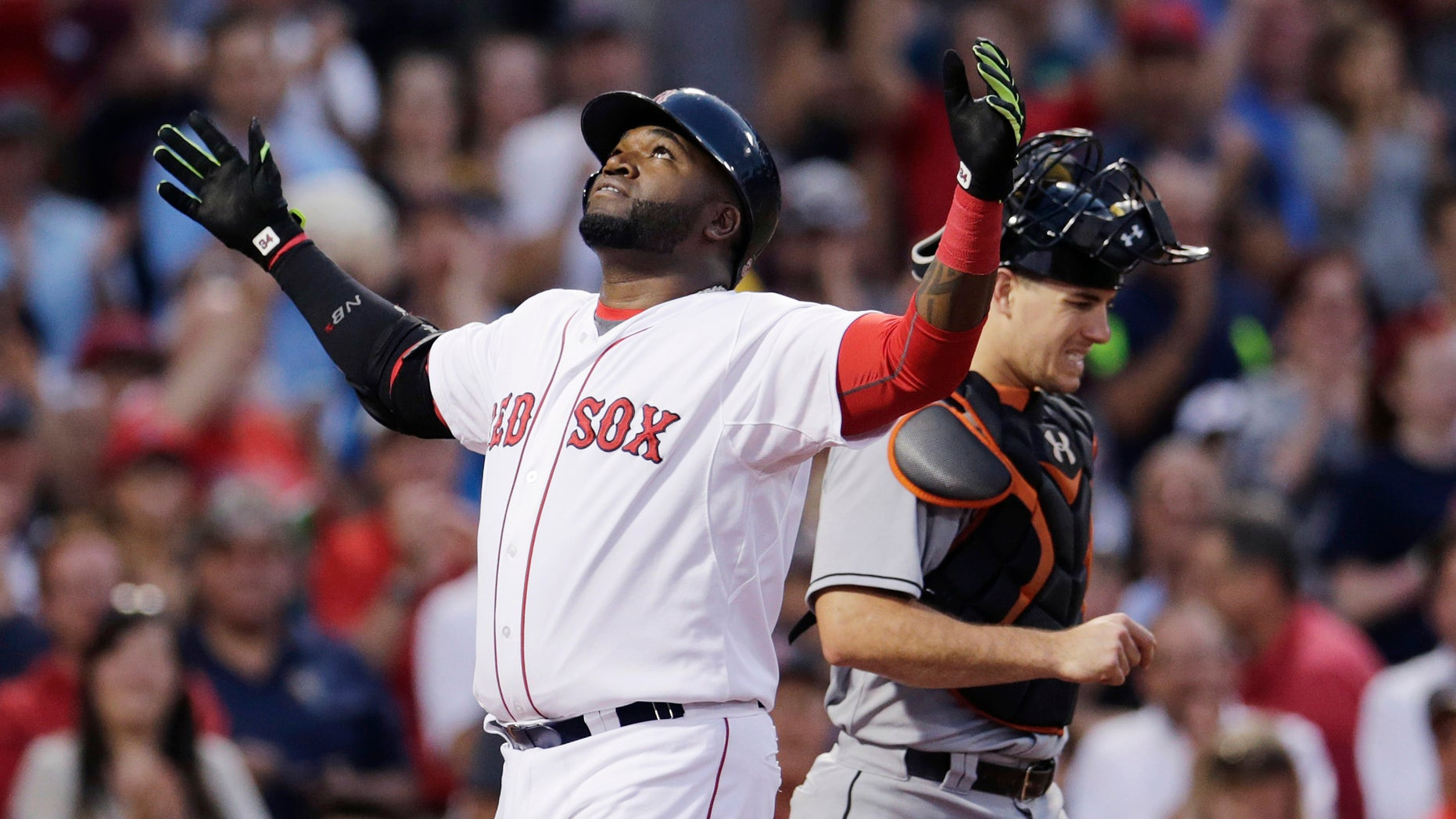 Boston Red Sox's David Ortiz reacts as he crosses home plate after his two-run home run during the third inning a baseball game at Fenway Park, Wednesday July 8, 2015, in Boston. At right is Miami Marlins catcher J.T. Realmuto. (AP Photo/Charles Krupa)