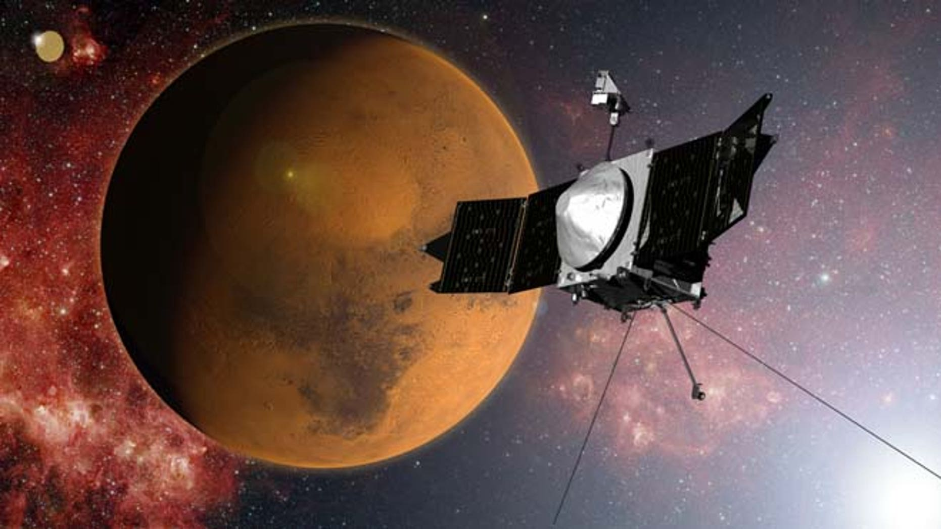 In this artist concept provided by NASA, the MAVEN spacecraft approaches Mars on a mission to study its upper atmosphere. (AP/NASA)