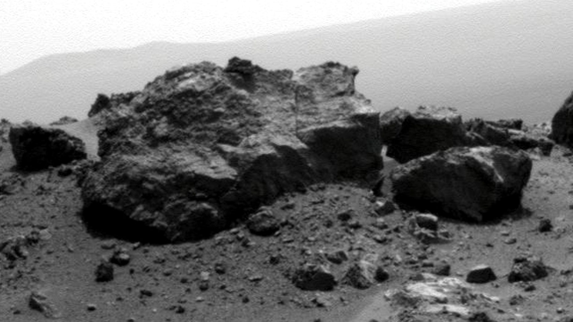 Aug. 13, 2011: NASA's Mars Exploration Rover Opportunity looked across a small crater on the rim of a much larger crater to capture this raw image from its panoramic camera during the rover's 2,685th Martian day, or sol, of work on Mars.