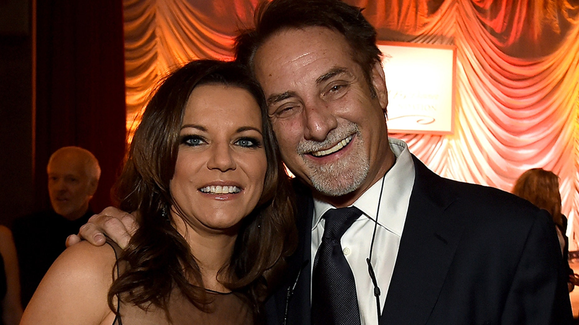 Martina McBride, left, and her husband John McBride, right, are being sued for $1 million by a former employee.