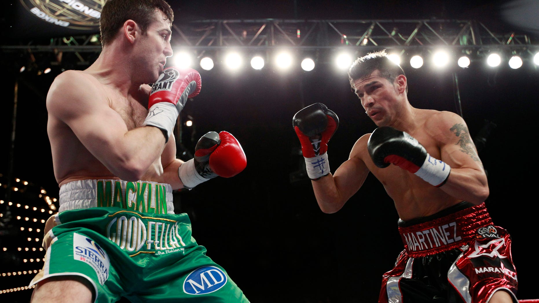 Matthew Macklin, left, and Sergio Martinez eye each other during the second round of a middleweight boxing bout Saturday, March 17, 2012, in New York. Martinez won the fight when it was stopped after the 11th round. (AP Photo/Frank Franklin II)