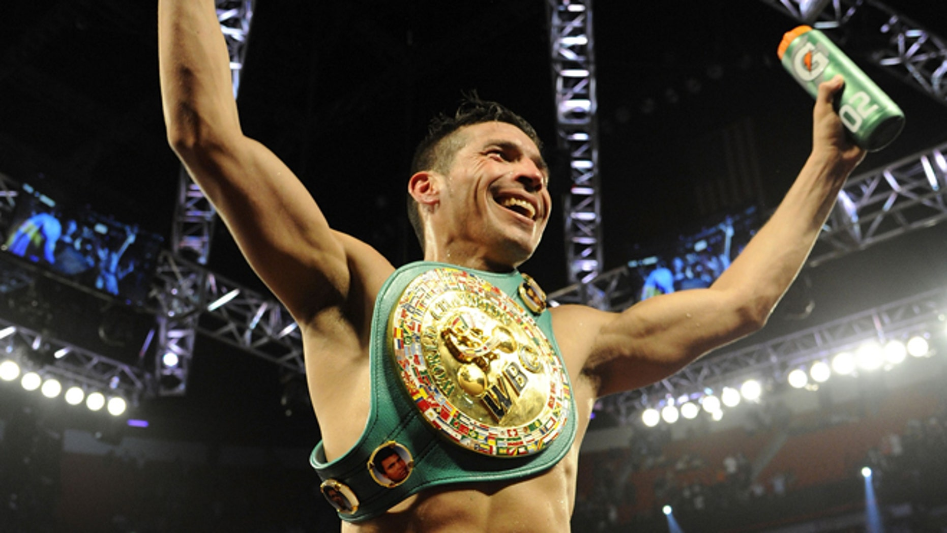 LAS VEGAS, NV - SEPTEMBER 15:  Sergio Martinez celebrates after defeating Julio Cesar Chavez Jr. in twelve rounds by unanimous decision for their WBC middleweight title fight at the Thomas & Mack Center on September 15, 2012 in Las Vegas, Nevada.  (Photo by Jeff Bottari/Getty Images)
