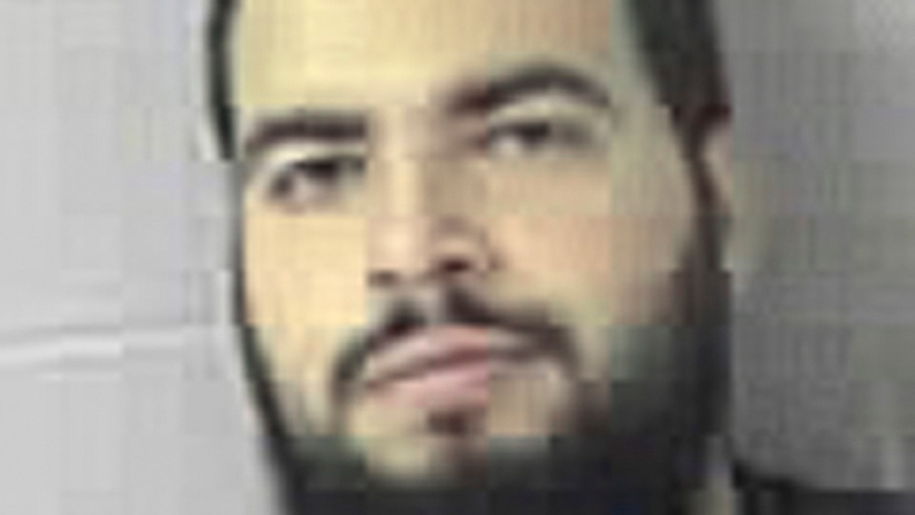 FILE - This Oct. 21, 2009, file booking photo provided by the Sudbury, Mass., Police Dept. shows Tarek Mehanna, of Sudbury, who was convicted of conspiring to help Al Qaeda.