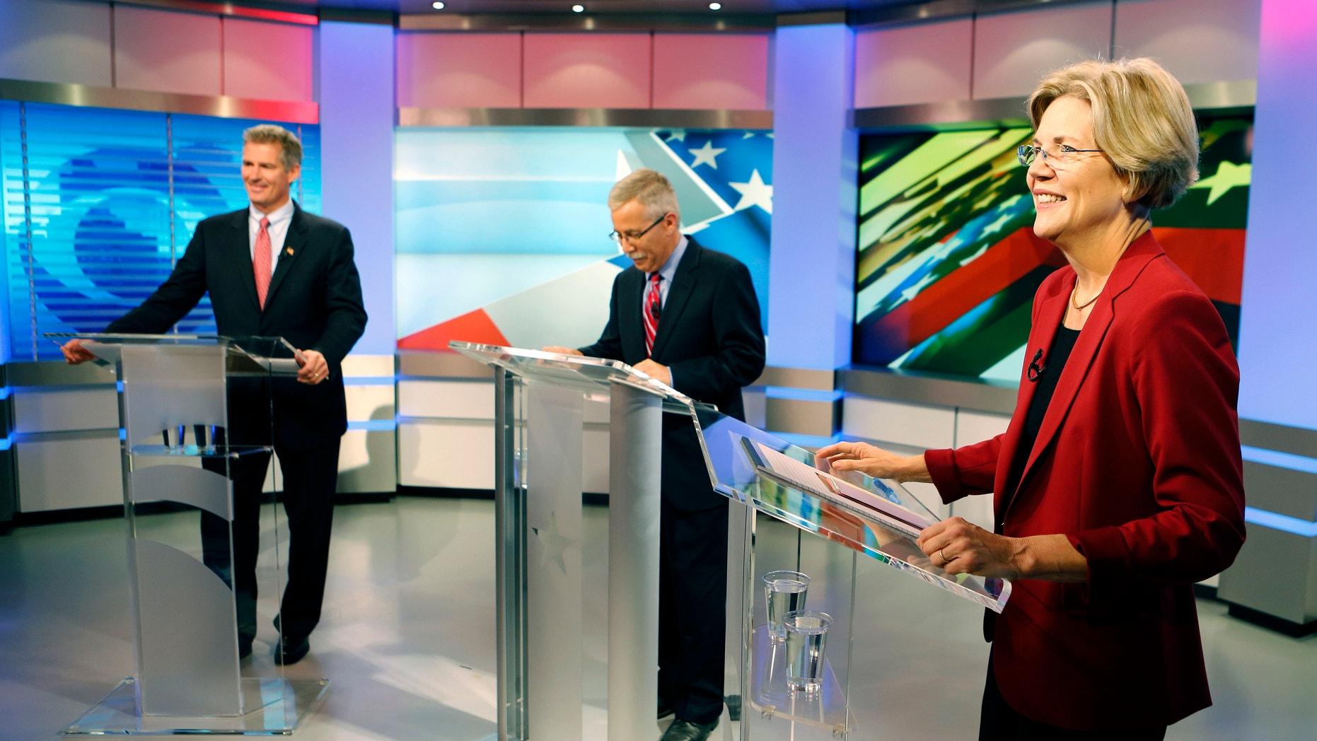 FILE: Sept. 20, 2012: Sen. Scott Brown, R-Mass., left, and Democratic challenger Elizabeth Warren before their first debate along with moderator Jon Keller, center.