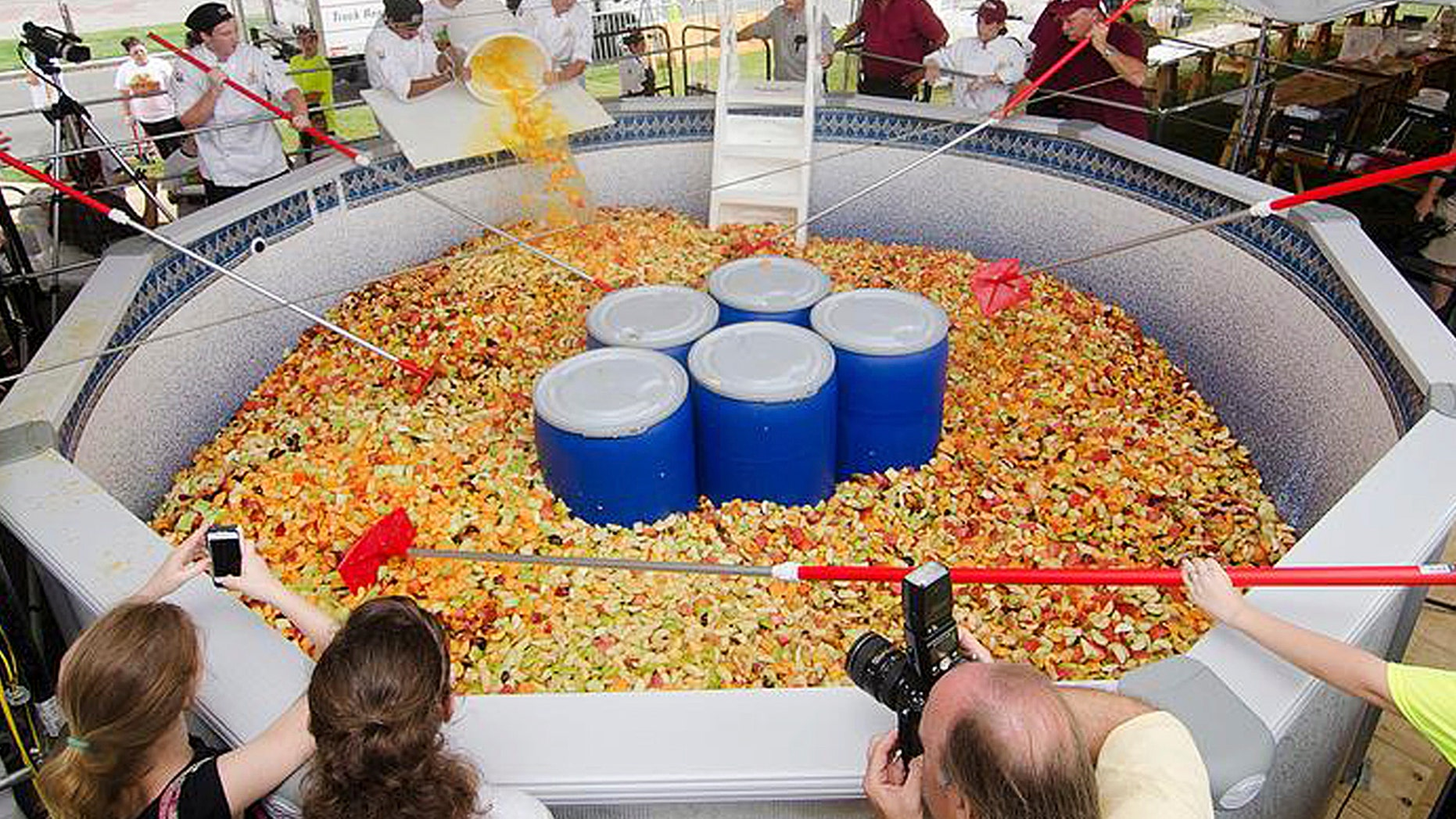 This Monday, Sept. 2, 2013 photo released on the University of Massachusetts, Amherst media relations website shows a fruit salad prepared on campus, and weighing more than 15,000 pounds. (AP Photo/University of Massachusetts, Amherst)