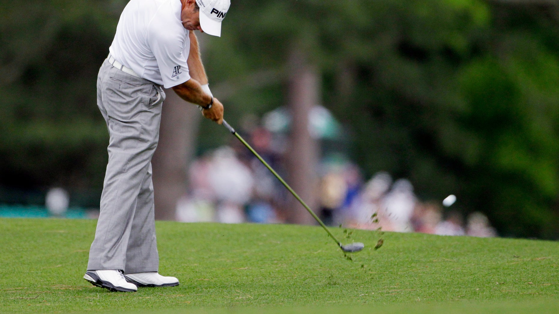 April 5: Lee Westwood, of England, hits his second shot on the 15th hole during the first round the Masters golf tournament  in Augusta, Ga.
