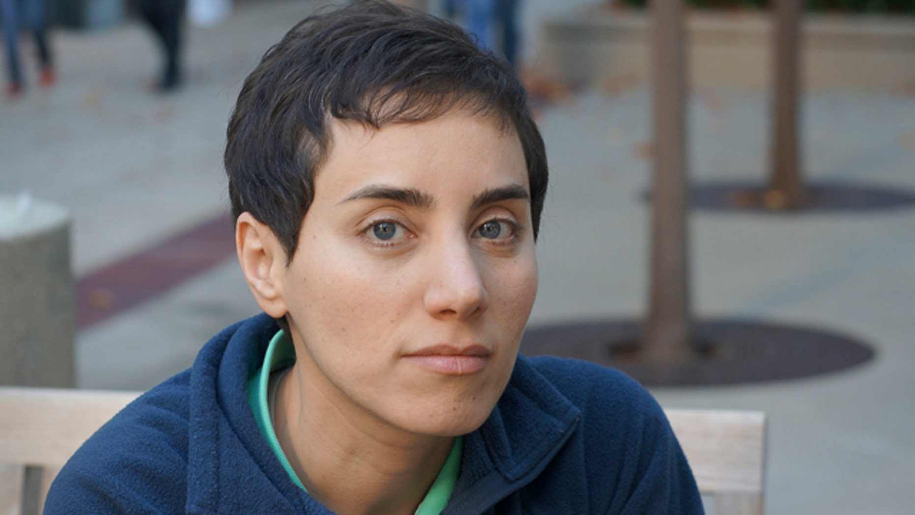 This undated photo provided by Professor Maryam Mirzakhani via Stanford shows her on the university's campus. On Wednesday, Aug. 13, 2014, the Iranian-born Stanford University professor became the first woman to win math's highest honor, the Fields Medal. (AP Photo/Maryam Mirzakhani via Stanford)