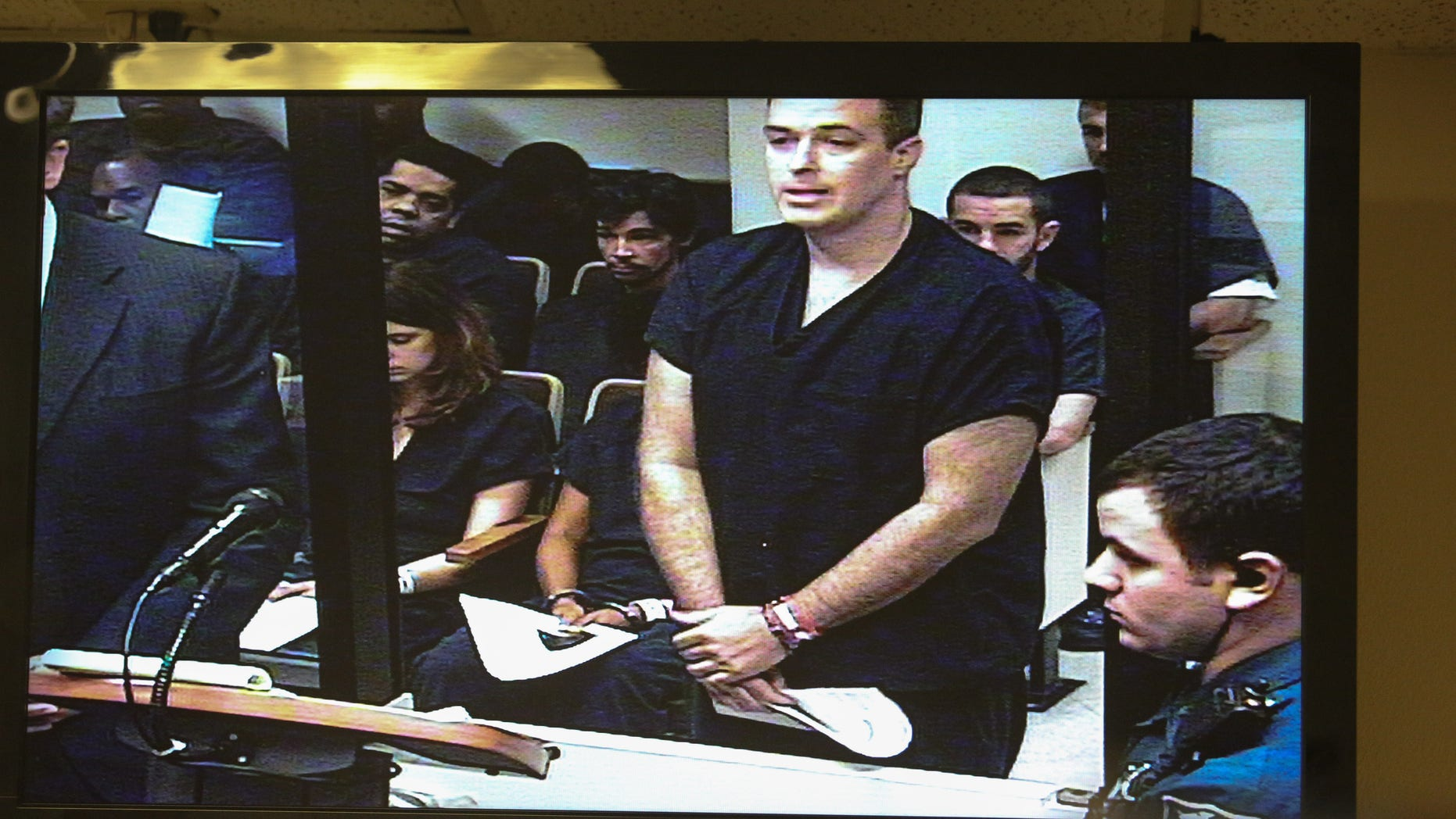 Matthew Apperson makes a first appearance in Seminole County court at the John E Polk correctional facility, seen on a video monitor,  in Sanford, Fla. on Saturday May 16, 2015. Apperson was charged Friday with aggravated assault with a deadly weapon, aggravated battery with a deadly weapon and firing a deadly missile into an occupied conveyance stemming from an incident involving George Zimmerman earlier in the week.  (Joshua C. Cruey/Orlando Sentinel via AP) MAGS OUT; NO SALES