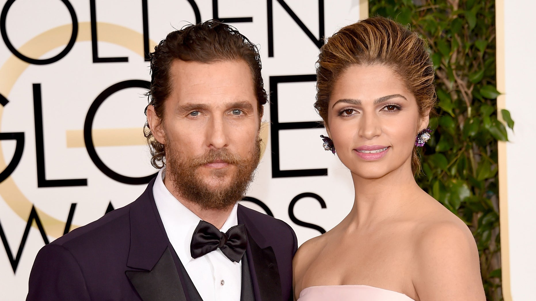 Matthew McConaughey and wife Camila Alves at the Golden Globe Awards on January 11, 2015 in Beverly Hills, California.