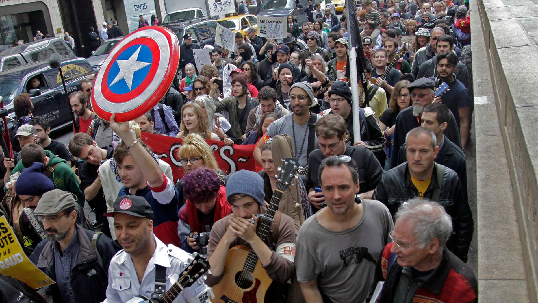 A coalition of activists join Occupy Wall Street in a May Day march from Bryant Park on Tuesday in New York. (AP Photo/Bebeto Matthews)