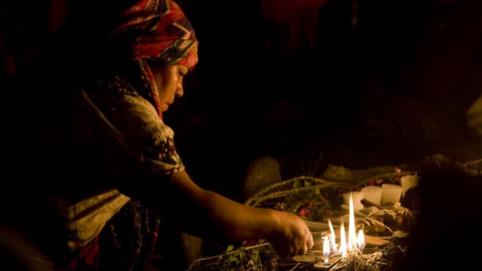 A Mayan priestess prays during a ceremony marking the Mayan solar new year.