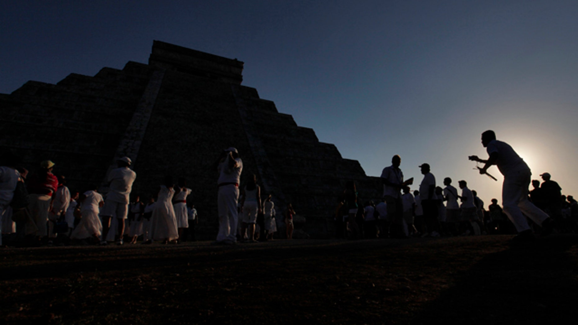 Over 15,000 people congregate in front of the famous pyramid at Chichen-Itza, Mexico to celebrate the arrival of the Equinox signaling the beginning of Spring, Sunday, March 20, 2011.  The famous Mayan ruin is popular at the Equinox when the serpent's back shows on the side of the stairway that leads to the top. (AP Photo/Standard Times , Peter Pereira)