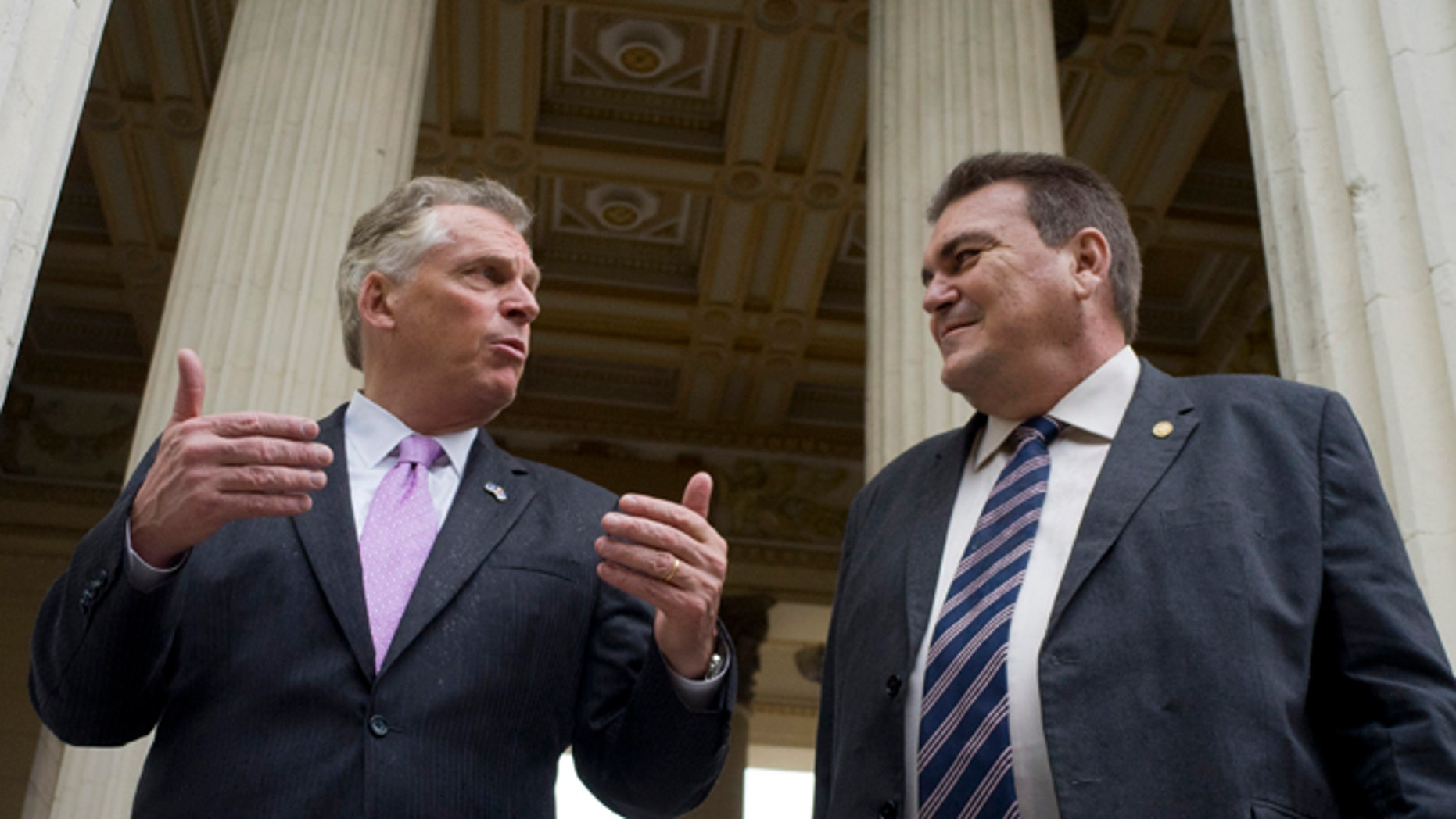 Virginia Governor Terry McAuliffe, left, talks with the dean of the University of Havana, Gustavo Suárez Cobreiro, in Havana, Cuba, Monday, Jan. 4, 2016. McAuliffe is in Havana heading a delegation that seeks to strengthen trade ties between the U.S. and Cuba, just over a year after the thawing of relations between the two countries. (AP Photo/Ramón Espinosa)