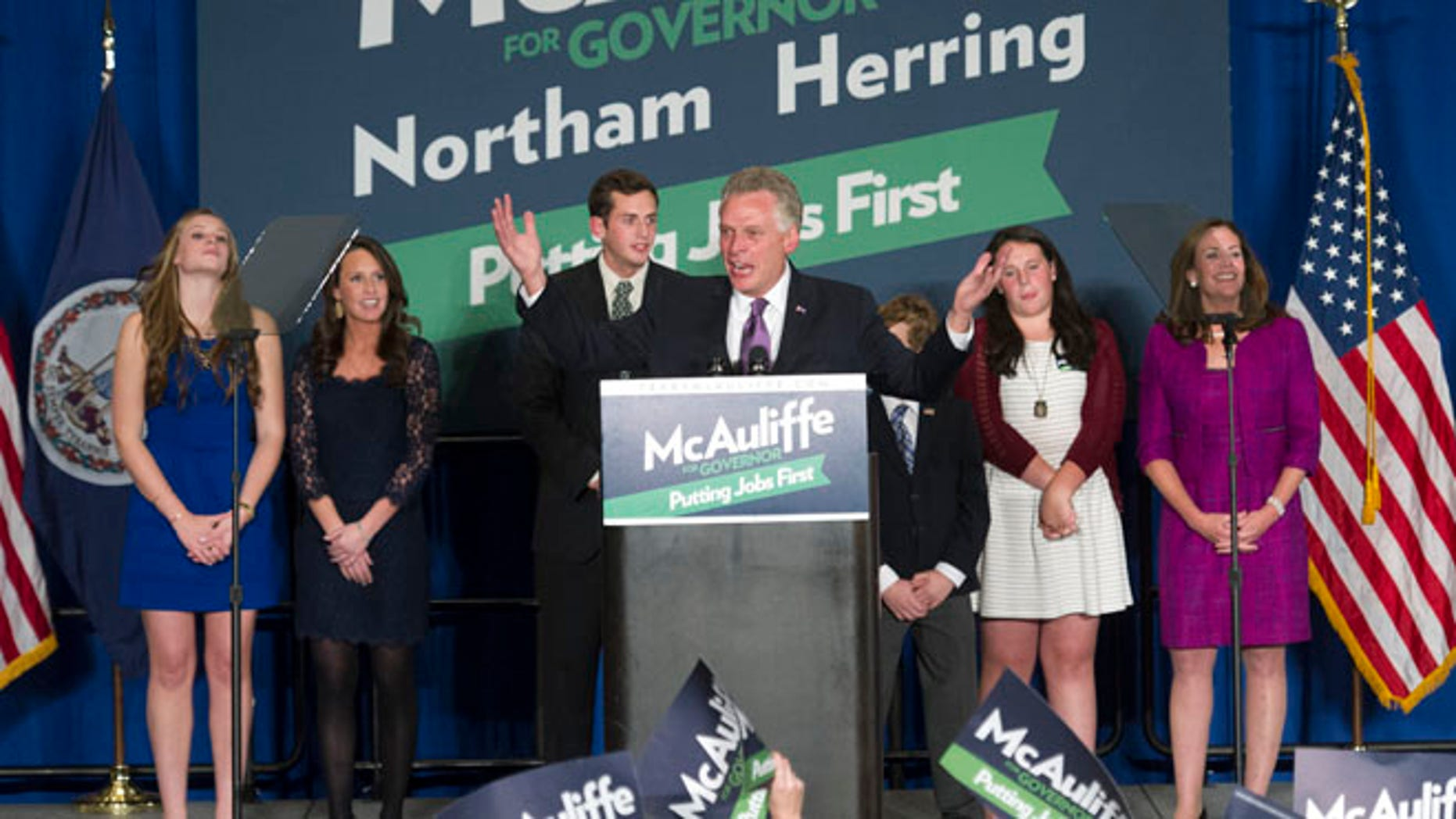 Democratic Virginia Gov.-elect Terry McAuliffe with his family during a party in Tysons Corner, Va., Tuesday, Nov. 5, 2013.