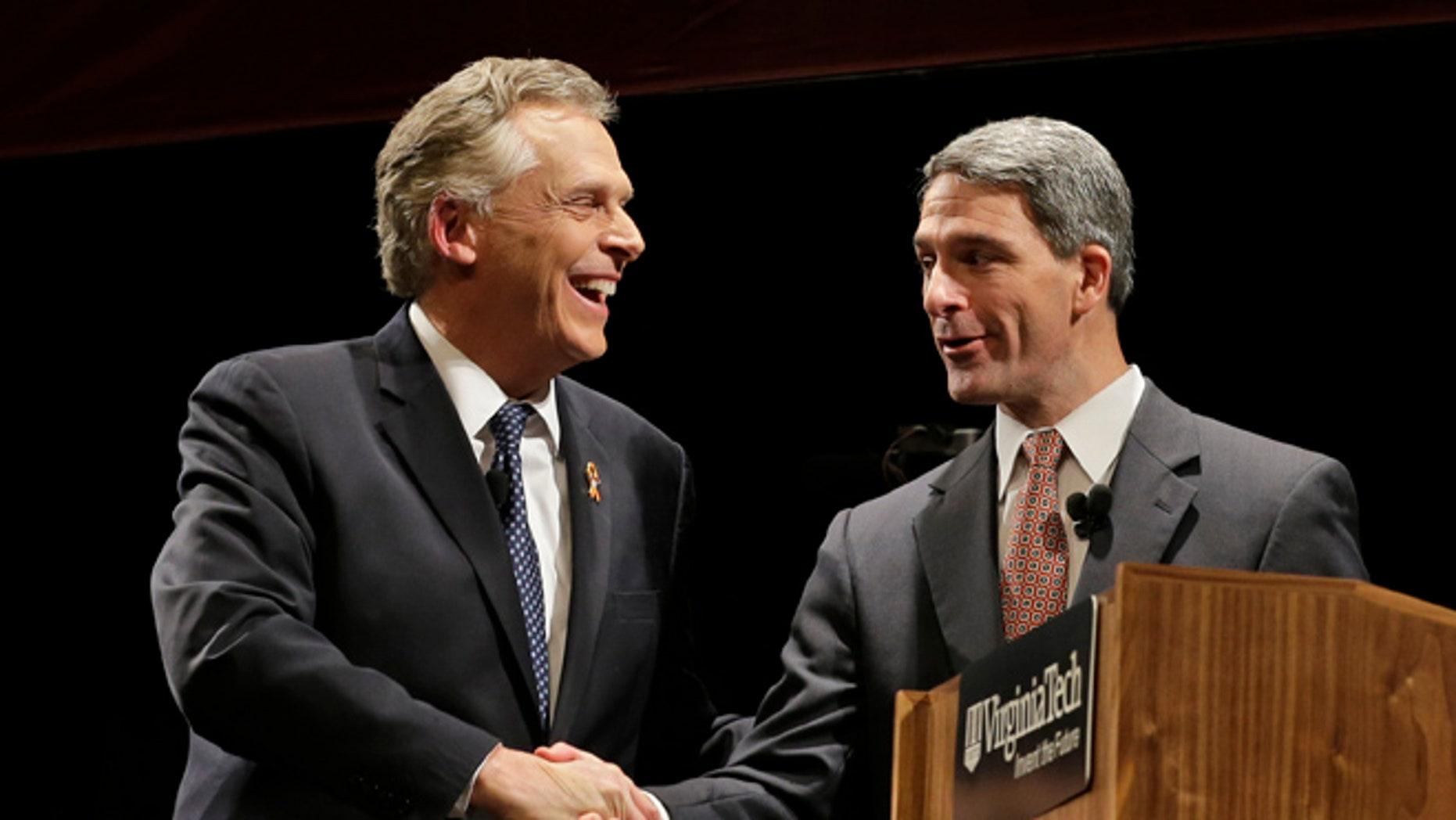 FILE: Oct. 24, 2013: Democratic gubernatorial candidate Terry McAuliffe, left, shakes hands with Republican challenger Virginia Attorney General Ken Cuccinelli at a debate at Virginia Tech in Blacksburg, Va.