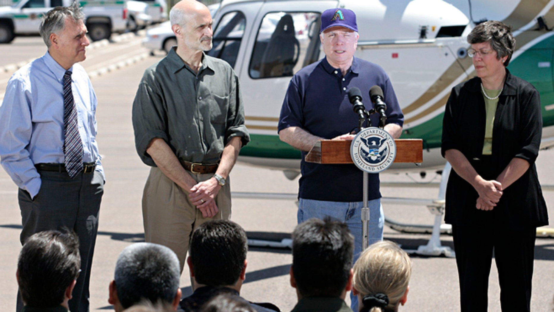 DOUGLAS, AZ - MAY 5:  U.S. Senator John McCain (R-AZ.) (Center-R) introduces U.S. Secretary of Homeland Security Michael Chertoff (Center-L) at the U.S. Border Patrol Station May 5, 2005 in Douglas, Arizona. Chertoff toured the border at Douglas and Yuma, Arizona and U.S. Border Patrol facilities along with U.S. Senator John McCain (R-AZ.), U.S. Senator Jon Kyl (R-AZ.) and Arizona Governor Janet Napolitano.  (Photo by Jeff Topping/Getty Images)