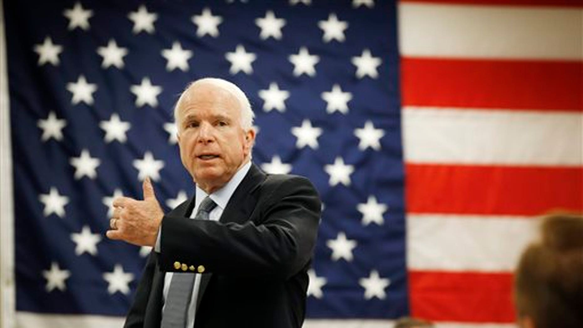 Tuesday, June 30, Sen. John McCain, R-Ariz., speaks with employees at Robertson Fuel Systems, in Tempe, Arizona.