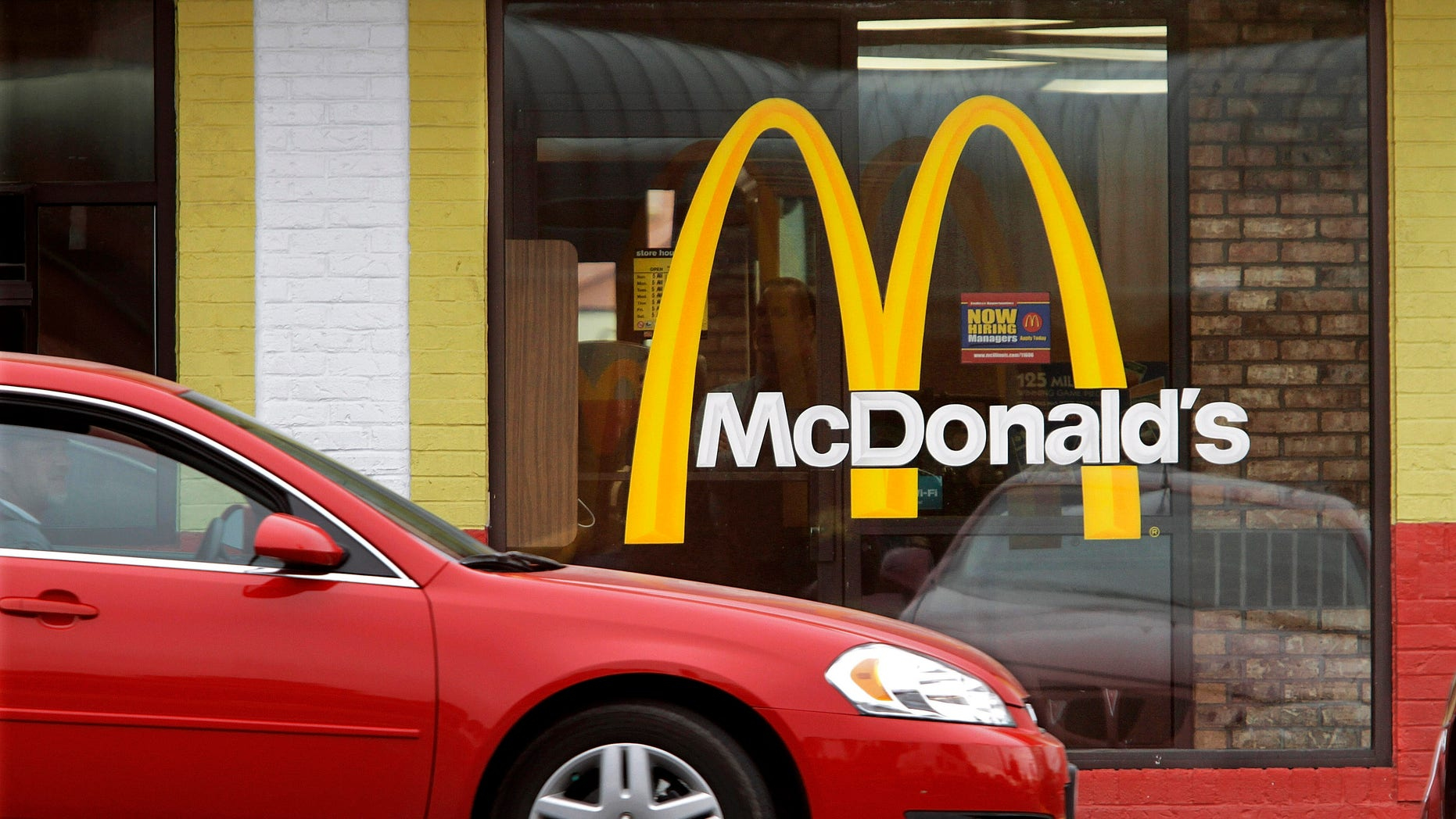 In this Oct. 17, 2011 file photo, a car moves through a McDonald's drive through window line, in Springfield, Ill.