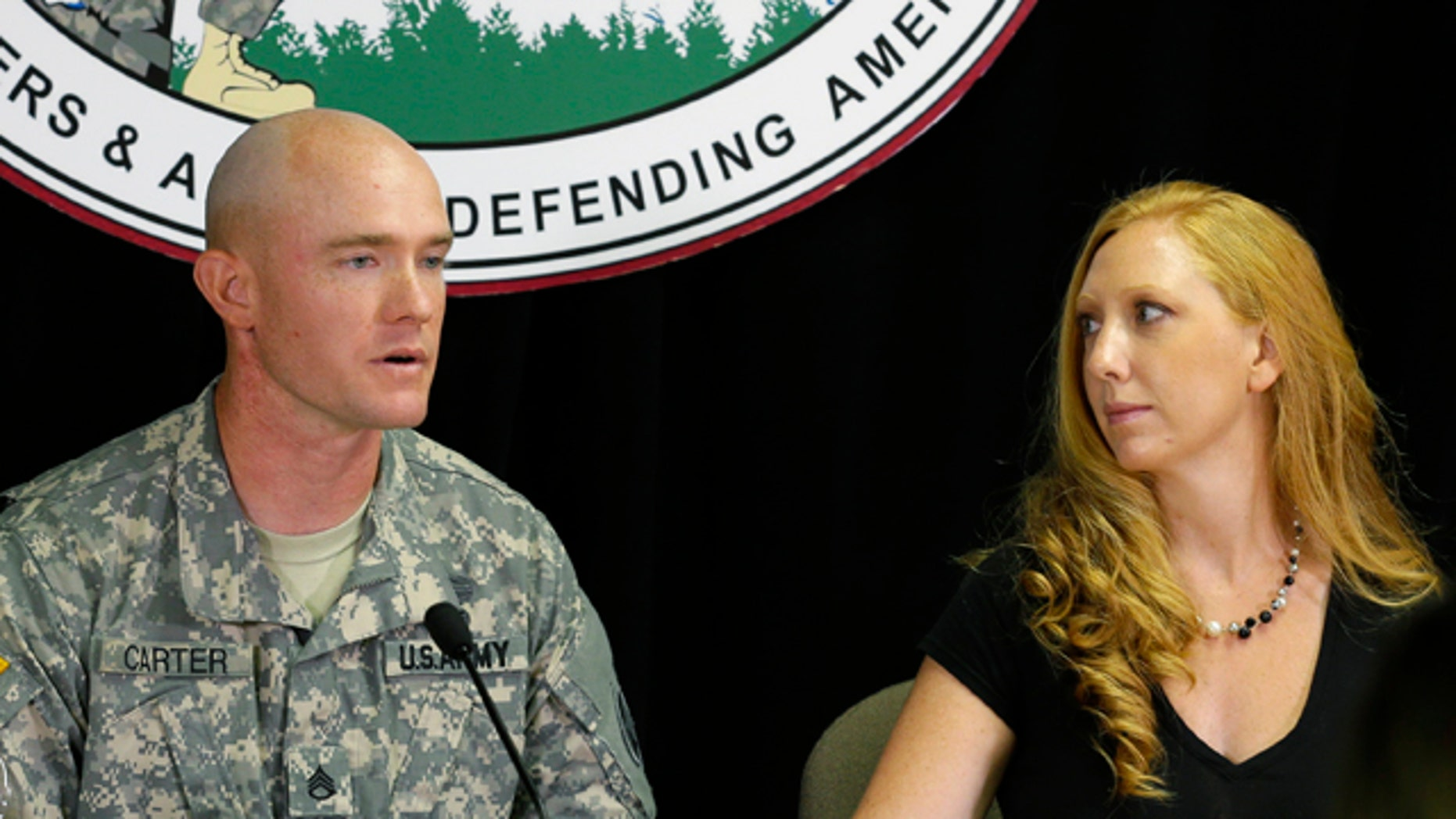 July 29, 2013: U.S. Army Staff Sgt. Ty Carter and his wife, Shannon Carter, talk to reporters at Joint Base Lewis-McChord in Washington state.