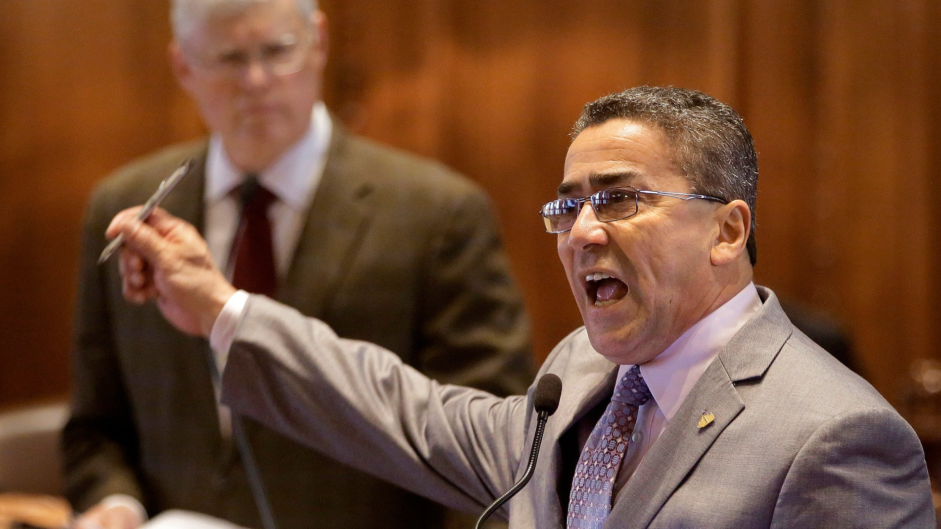 Illinois Sen. William Delgado, D-Chicago, agues medical marijuana legislation while on the Senate floor during session at the Illinois State Capitol Friday, May 17, 2013 in Springfield, Ill. (AP Photo/Seth Perlman)